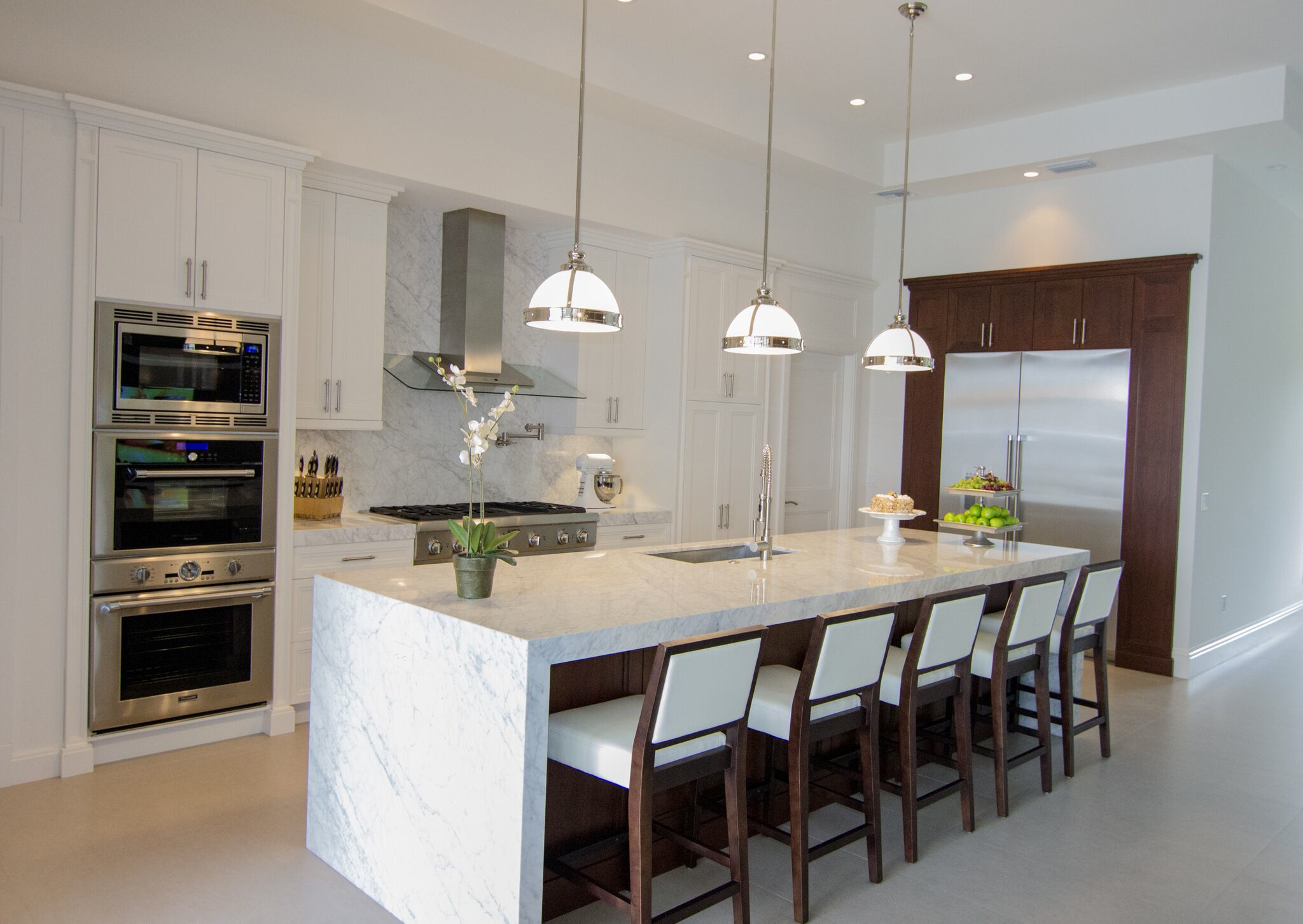 ELEGANT LARGE ISLAND WITH WATERFALL MARBLE TOPS by Chelsea Design