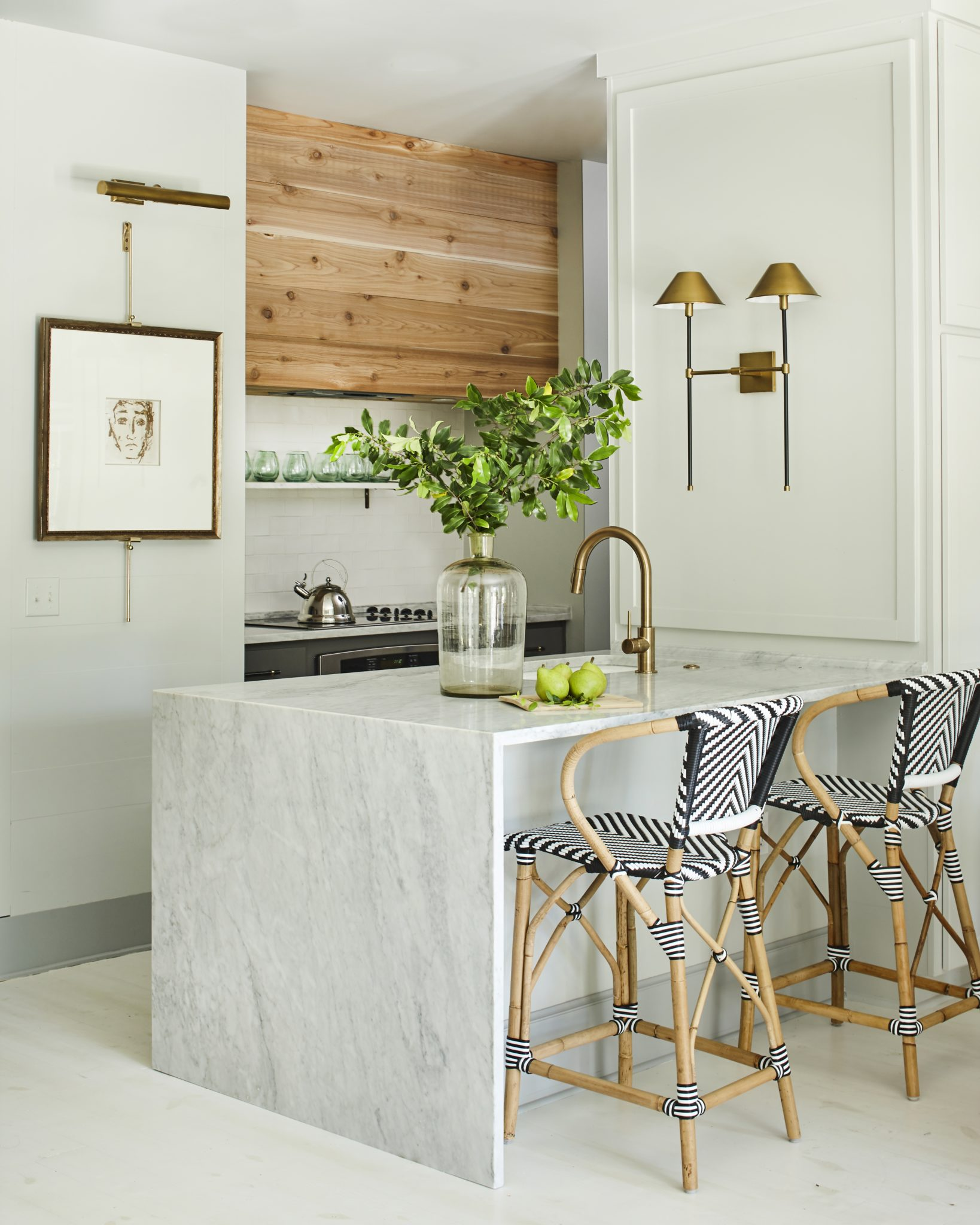 Marble waterfall countertop, wood shiplap hood and bistro counter stools by Ashley Gilbreath Interior Design