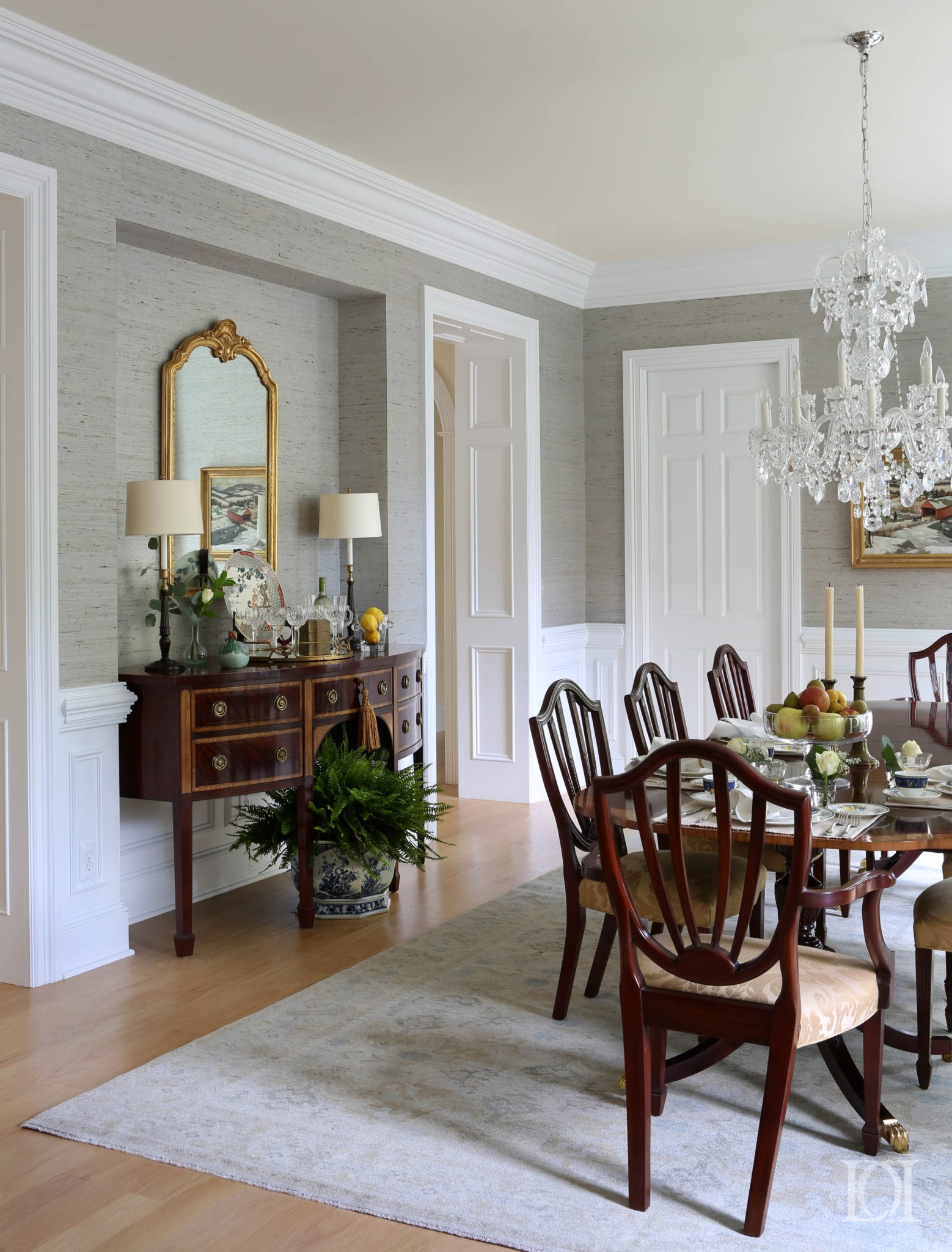 Dining Room with oriental rug, crystal chandelier and grass cloth wallpaper by Deborah Leamann Interior Design