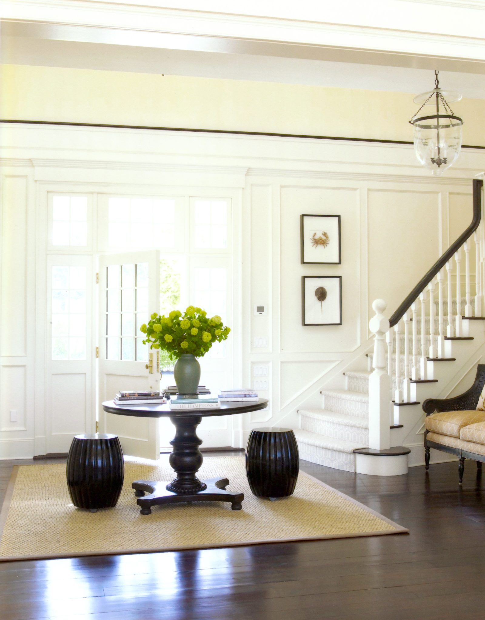 A bright and airy foyer by Ken Gemes Interiors