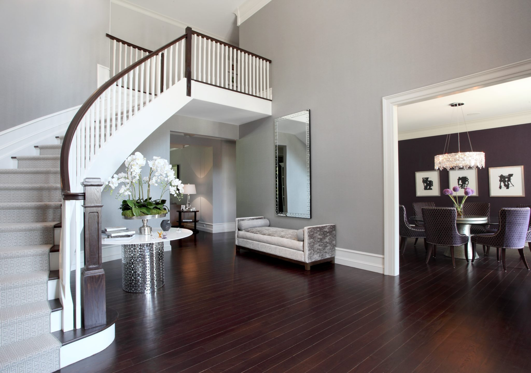 Glamorous entry foyer with center table and upholstered bench by Patricia Bonis Interiors
