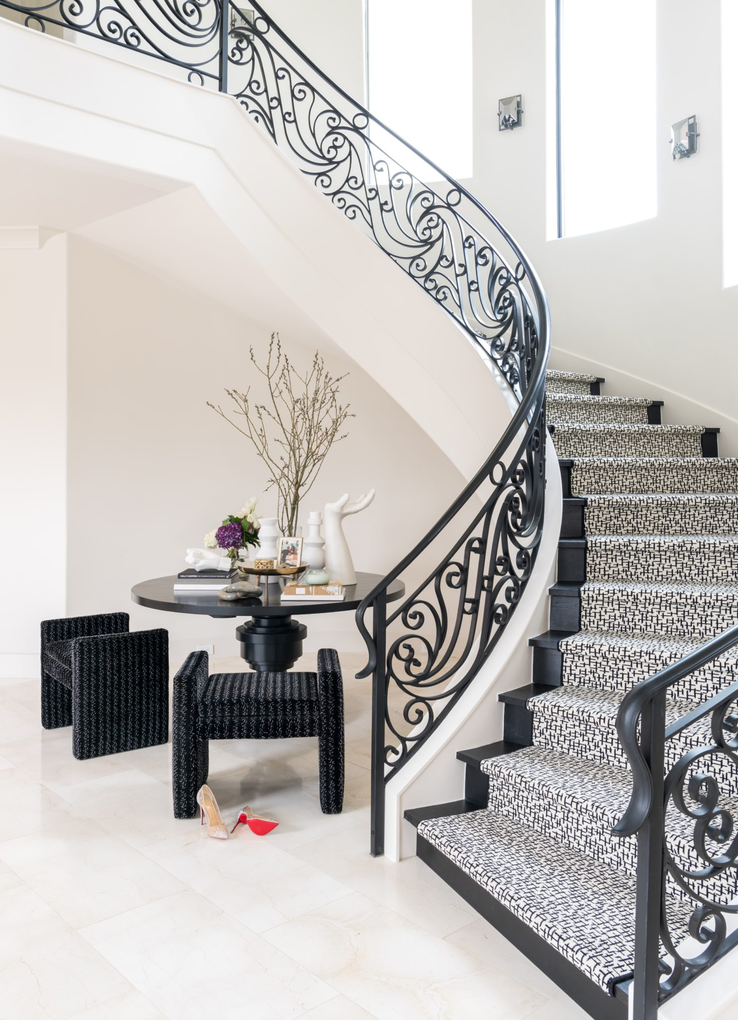 Glamorous grand entrance to beautiful, luxurious staircase and seating area by Laura U, Inc.