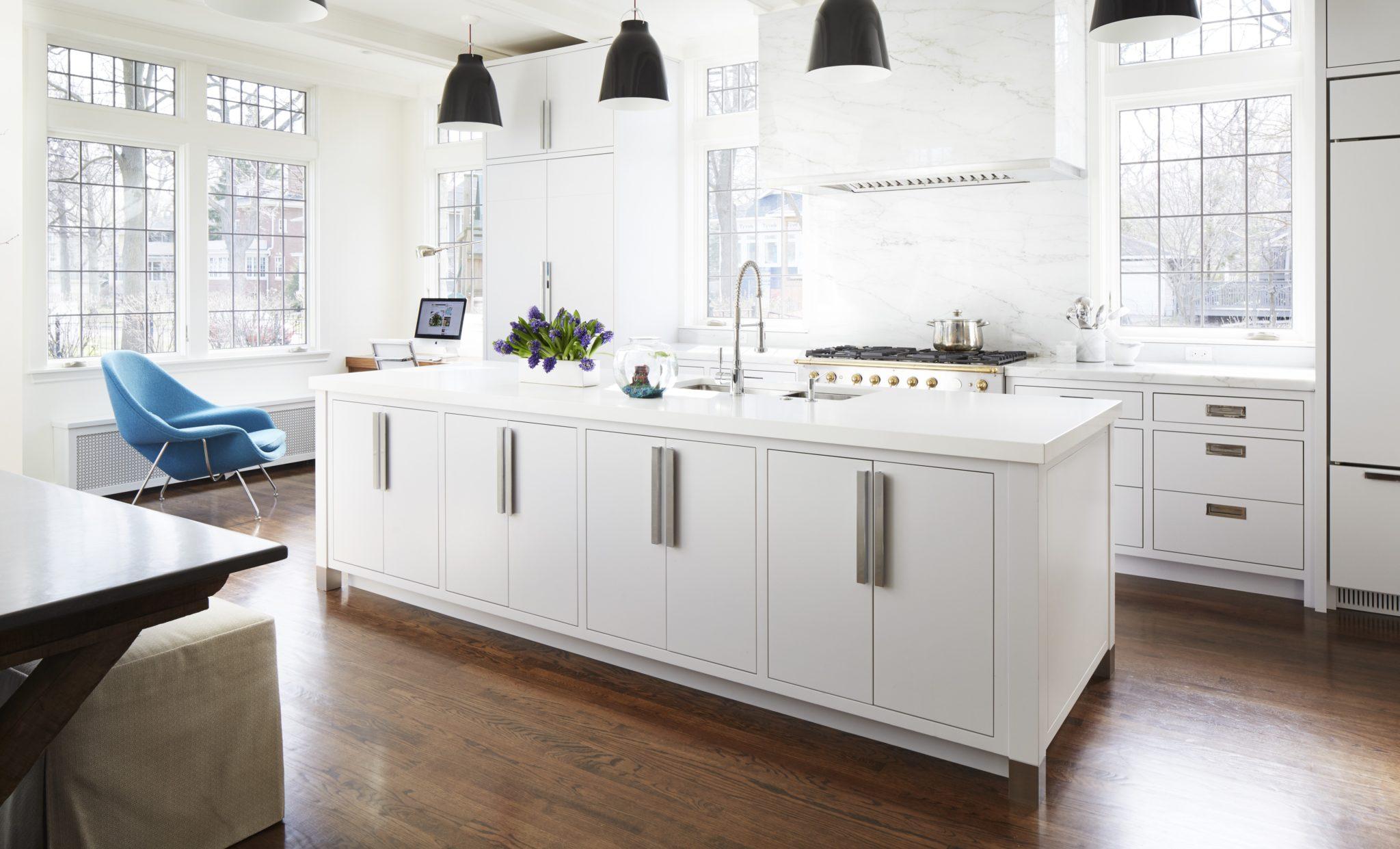 Modern kitchen with a marble hood by Amy Kartheiser Design