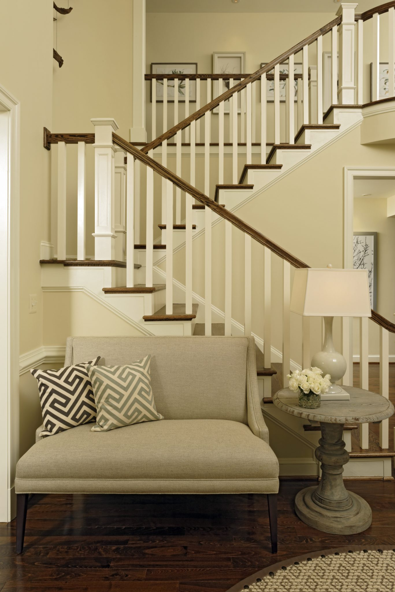 Purcellville, Virginia foyer, featuring a soft linen settee. By Paula Grace Designs – Signature Grace