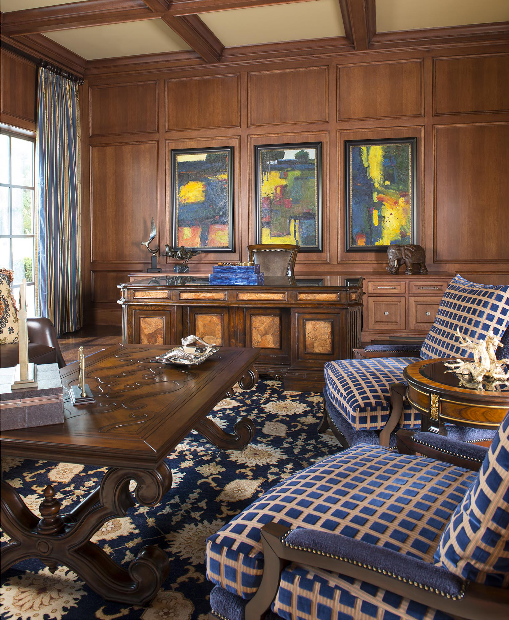 Abstract, colorful artwork transformed this traditional study. by Wesley-Wayne Interiors