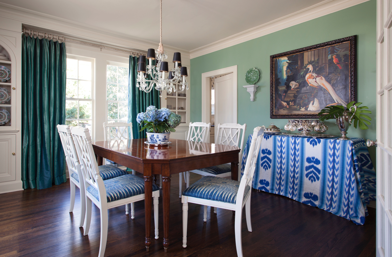 "Farrow & Ball's Breakfast Room Green (No. 81)  ""This colorful home in Austin has an easy flow from room to room. In the dining room, which is right off the entry and visible from the front door, we wanted to instantly grab the eye and be a bit more bold but still coordinate with the other strong elements of the room. We chose Farrow & Ball's Breakfast Room Green for the space because it has just the right amount of blue in it to make the transition seamless.""  Meredith Ellis, of Meredith Ellis Design"