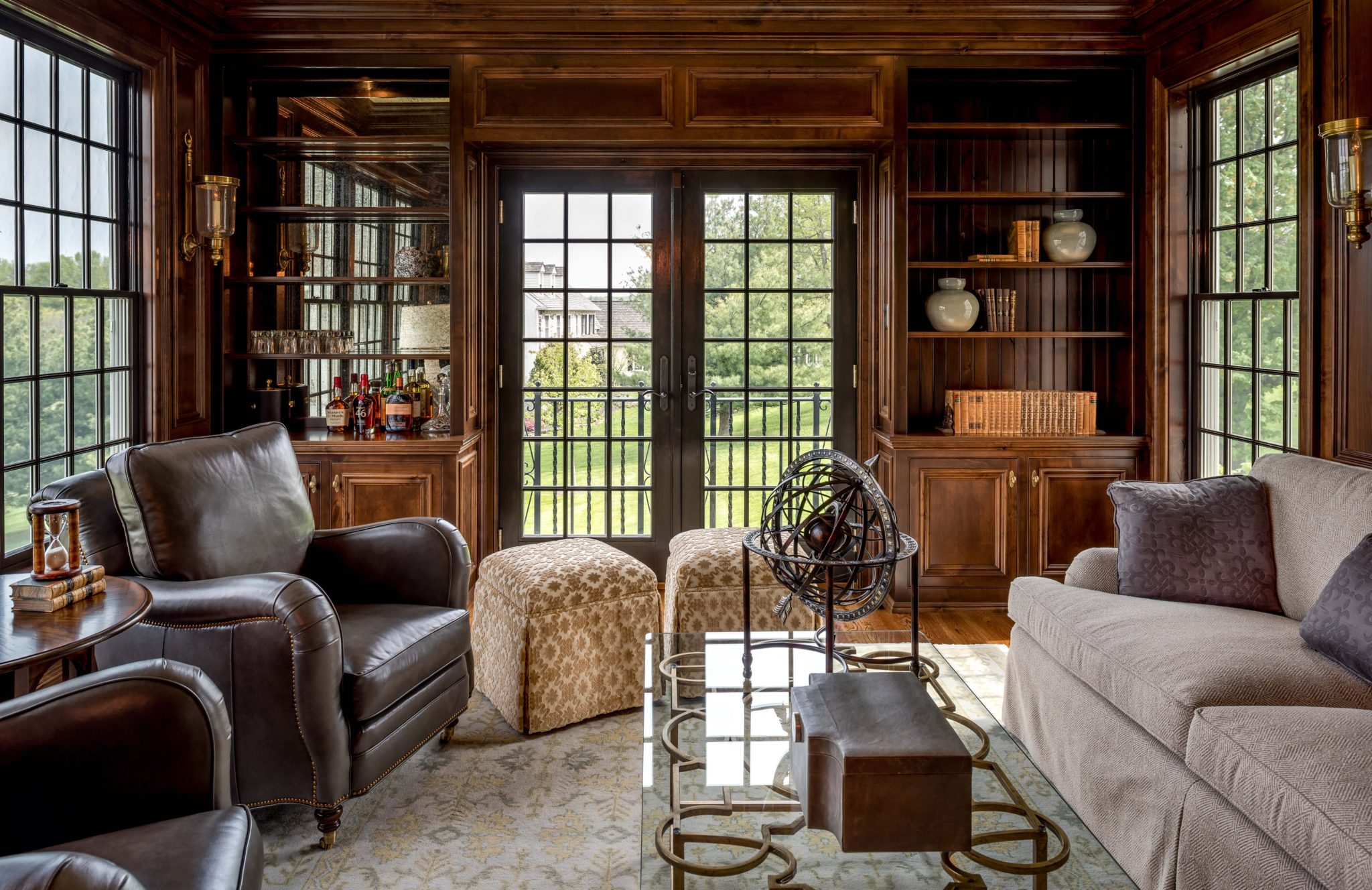 Gentlemen's Study with dark wood paneling and built-ins by Period Architecture