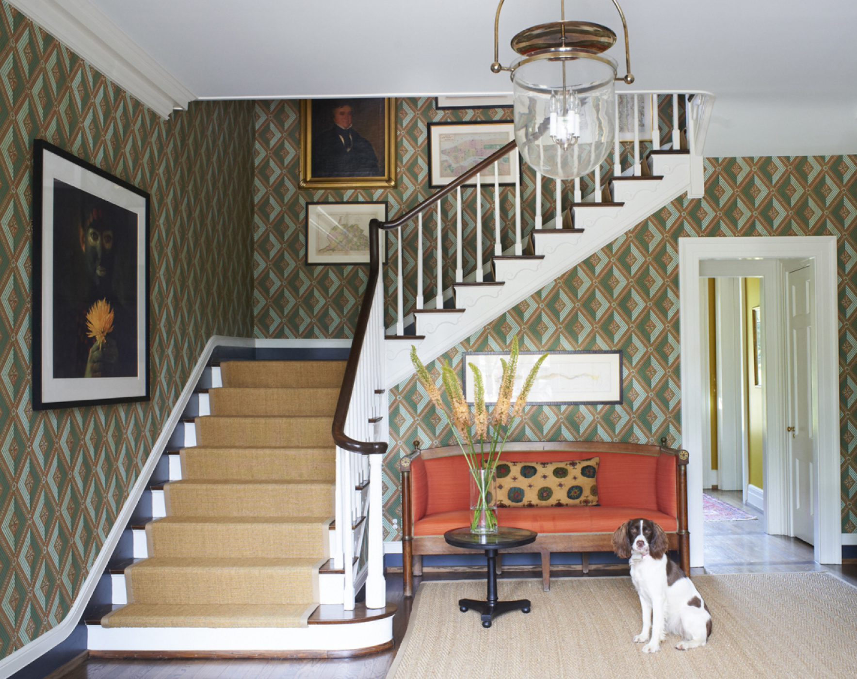 Nashville hall with hand-blocked wallpaper and orange horsehair on French canape by Brockschmidt & Coleman, LLC