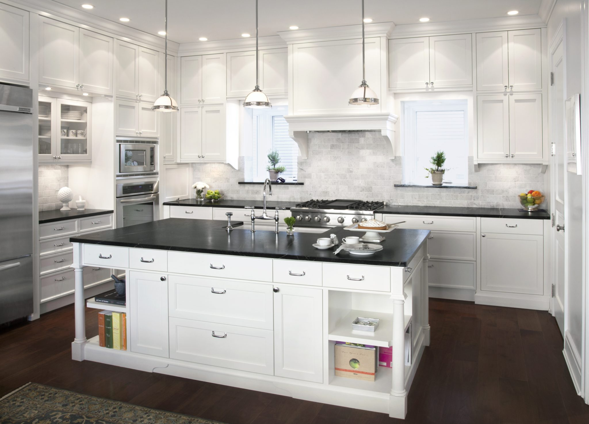 Traditional English kitchen with soapstone counters and marble backsplash by Randall Architects, Inc.