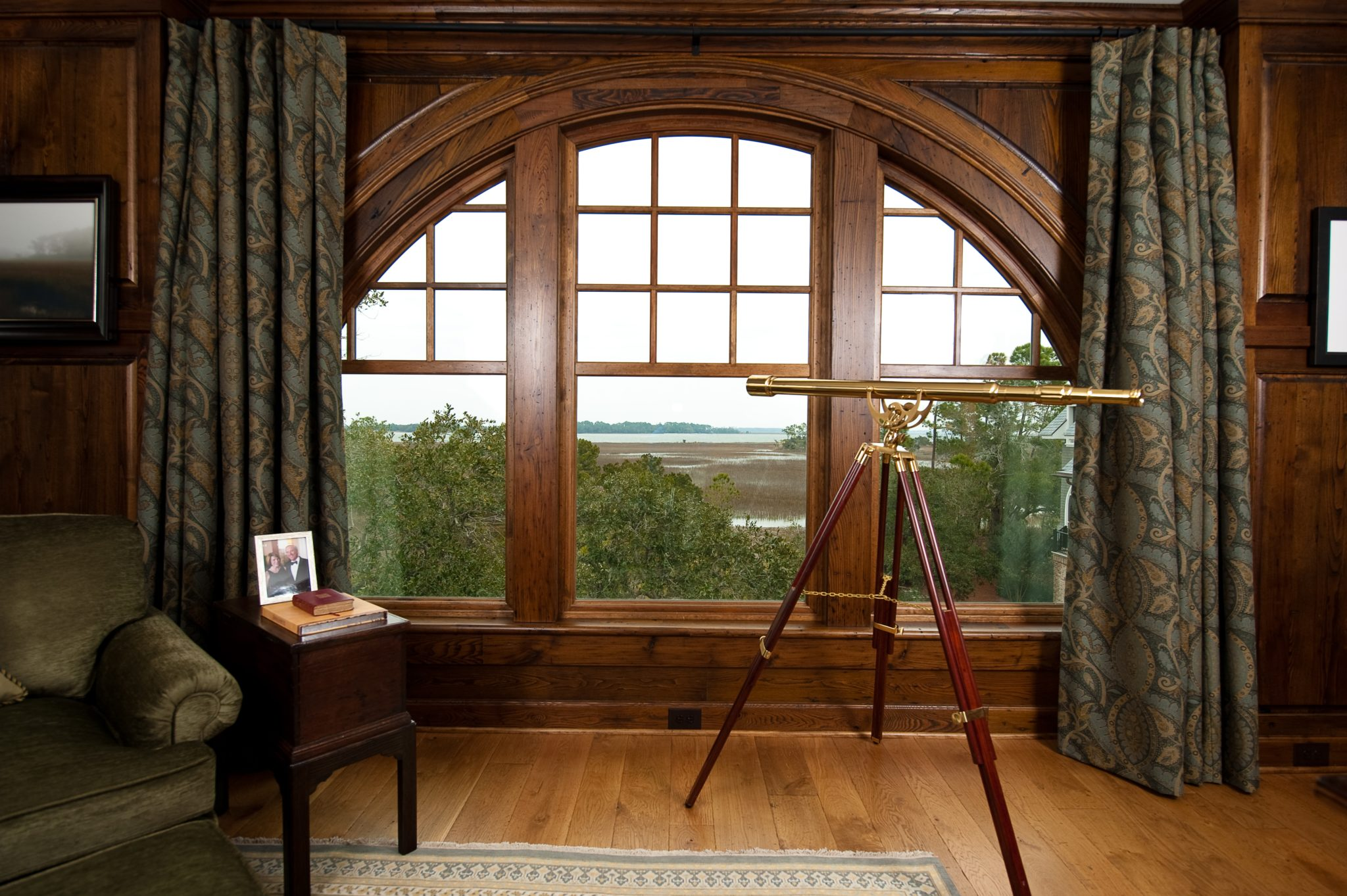 Home Office with Arched Window, Walnut Paneling and a Beautiful River View by Island Architects