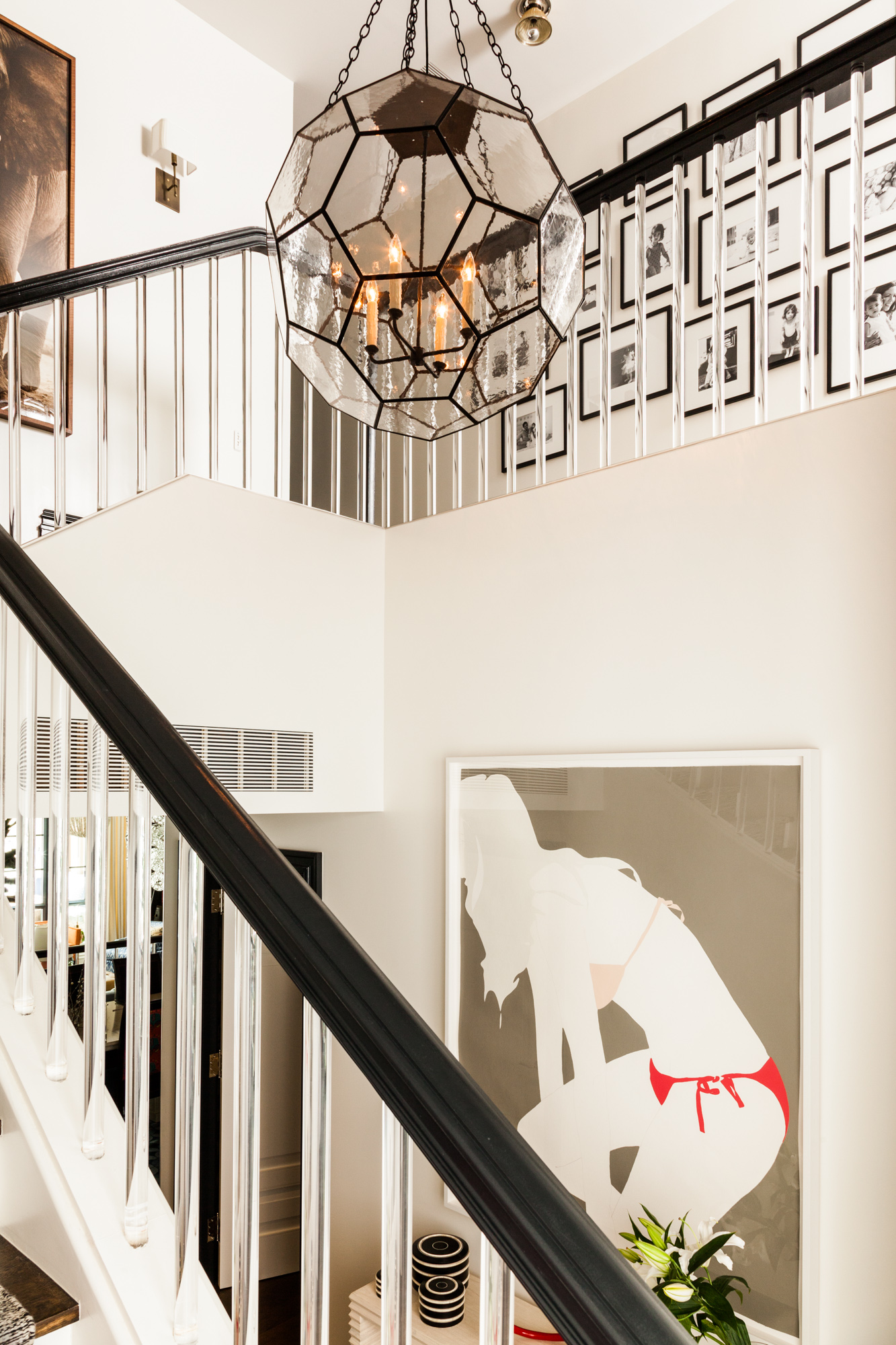 Stairwell with lucite banisters by Sara Gilbane Interiors