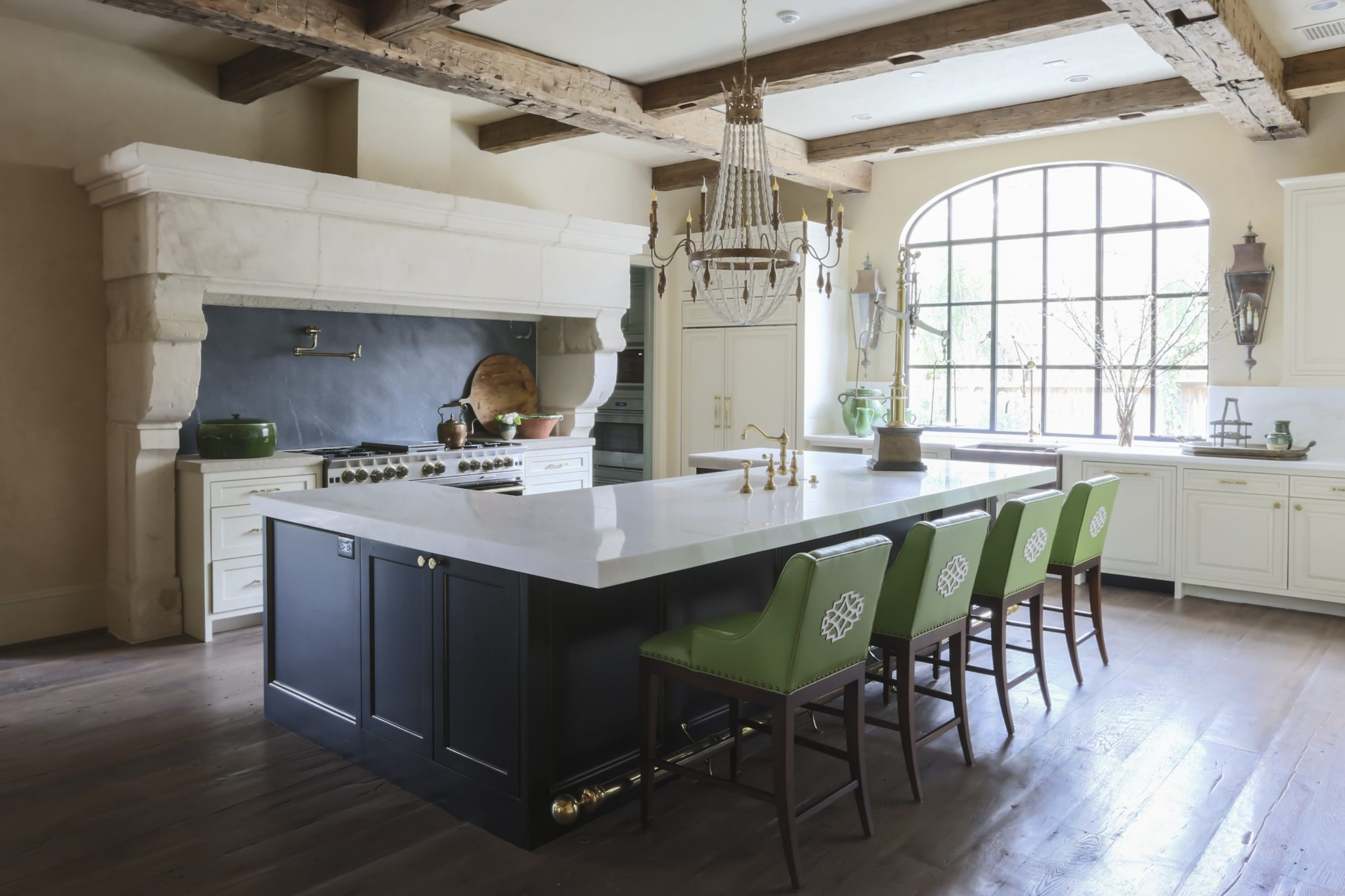 French transitional kitchen with steel windows, reclaimed beams and bright green twist by Triangle Interiors