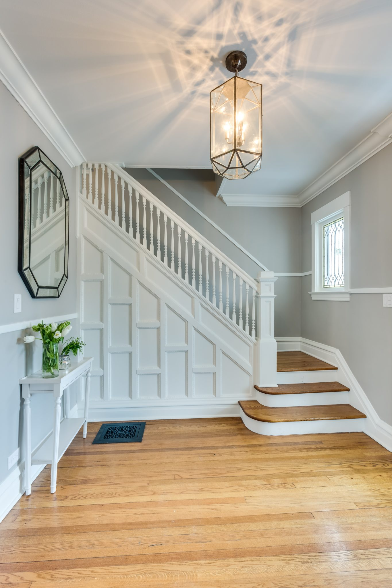 Victorian Renovation, Foyer with white crown molding by Rae Duncan Interior Design