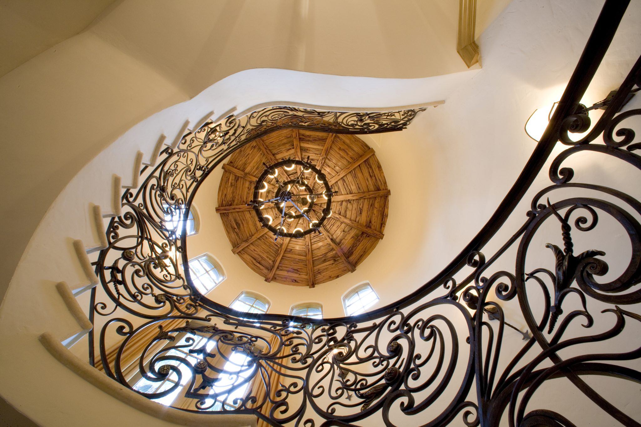 French Provincial Res- Stair Hall. Wrought iron railings, pecky cypress ceiling by Gonzalez-Abreu   Alas Architects (GAA)
