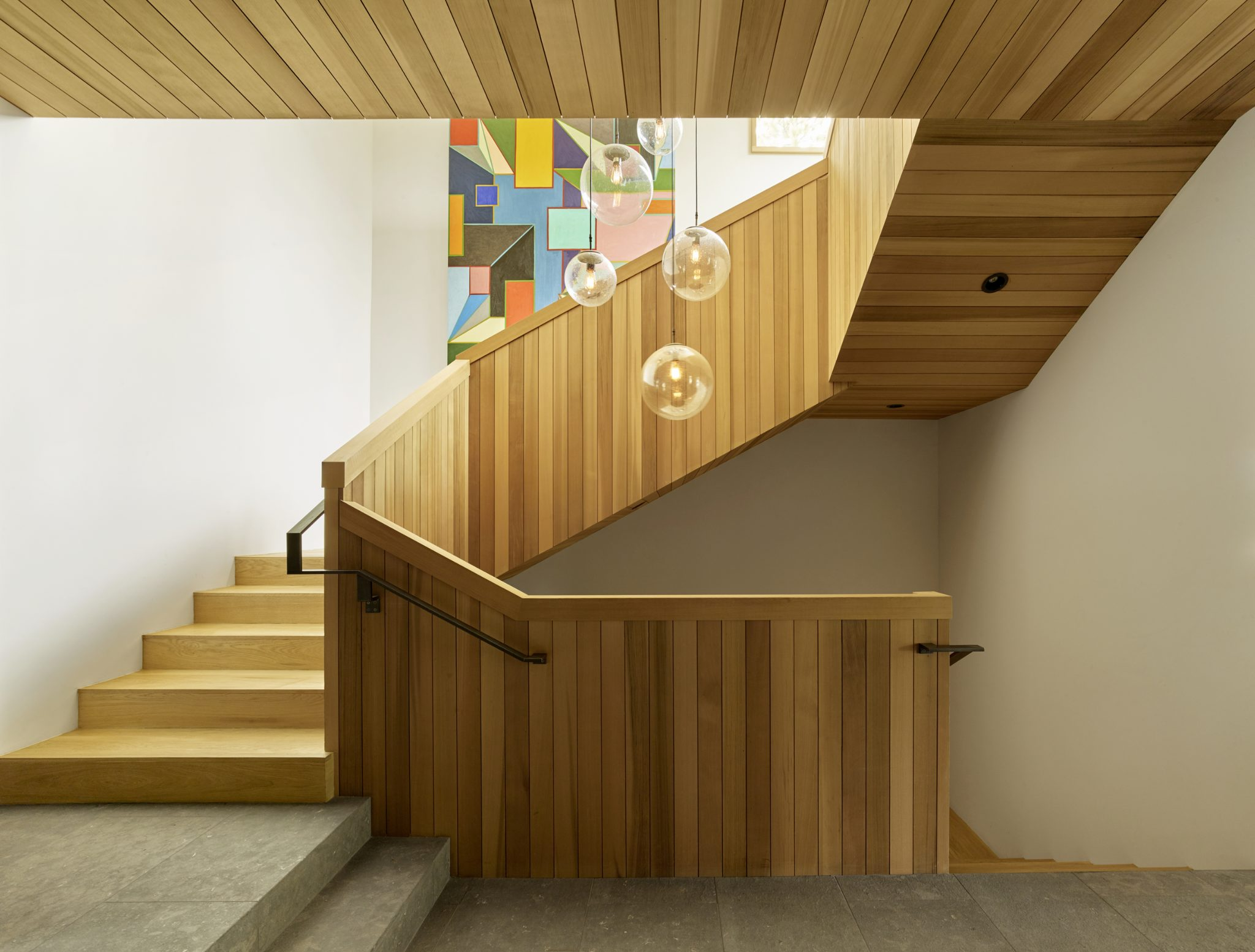 Tahoe Marvel, Stair detail in oak paneling with a custom Chandelier. by Kelly Hohla Interiors