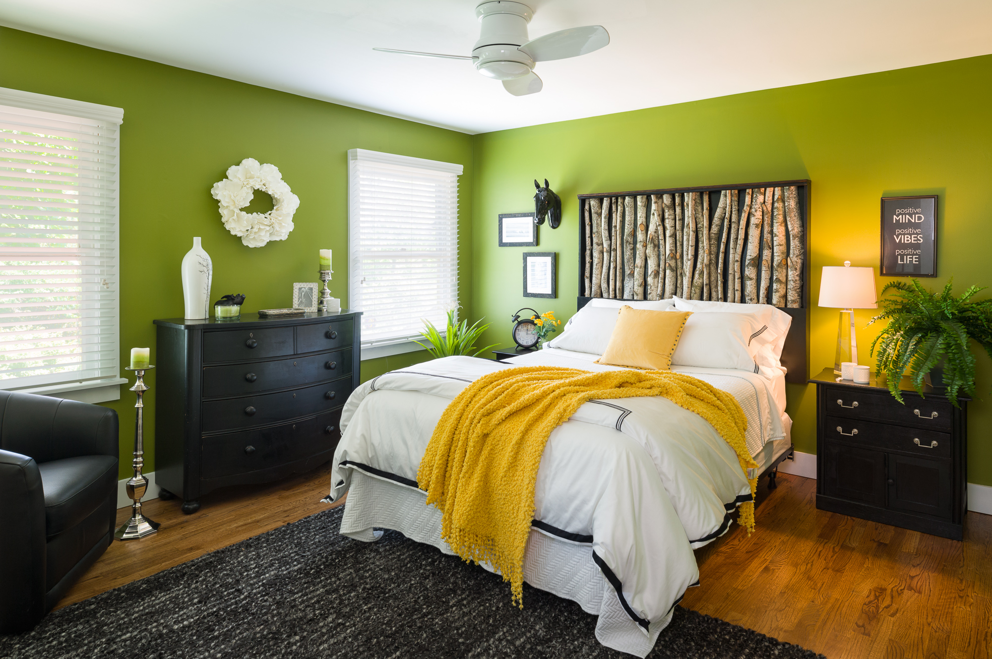 "Benjamin Moore's Dark Celery (#2146-10)  ""The owners of this Colonial home in central New Jersey wanted a guest bedroom that felt like a boutique hotel and embraced their love of the outdoors and bold color. This green creates a rich setting for the crisp white bedding and black and nature-inspired accents and creates a comfortable bedroom that welcomes guests.""  Iris Houlihan, of Ella Design Group"