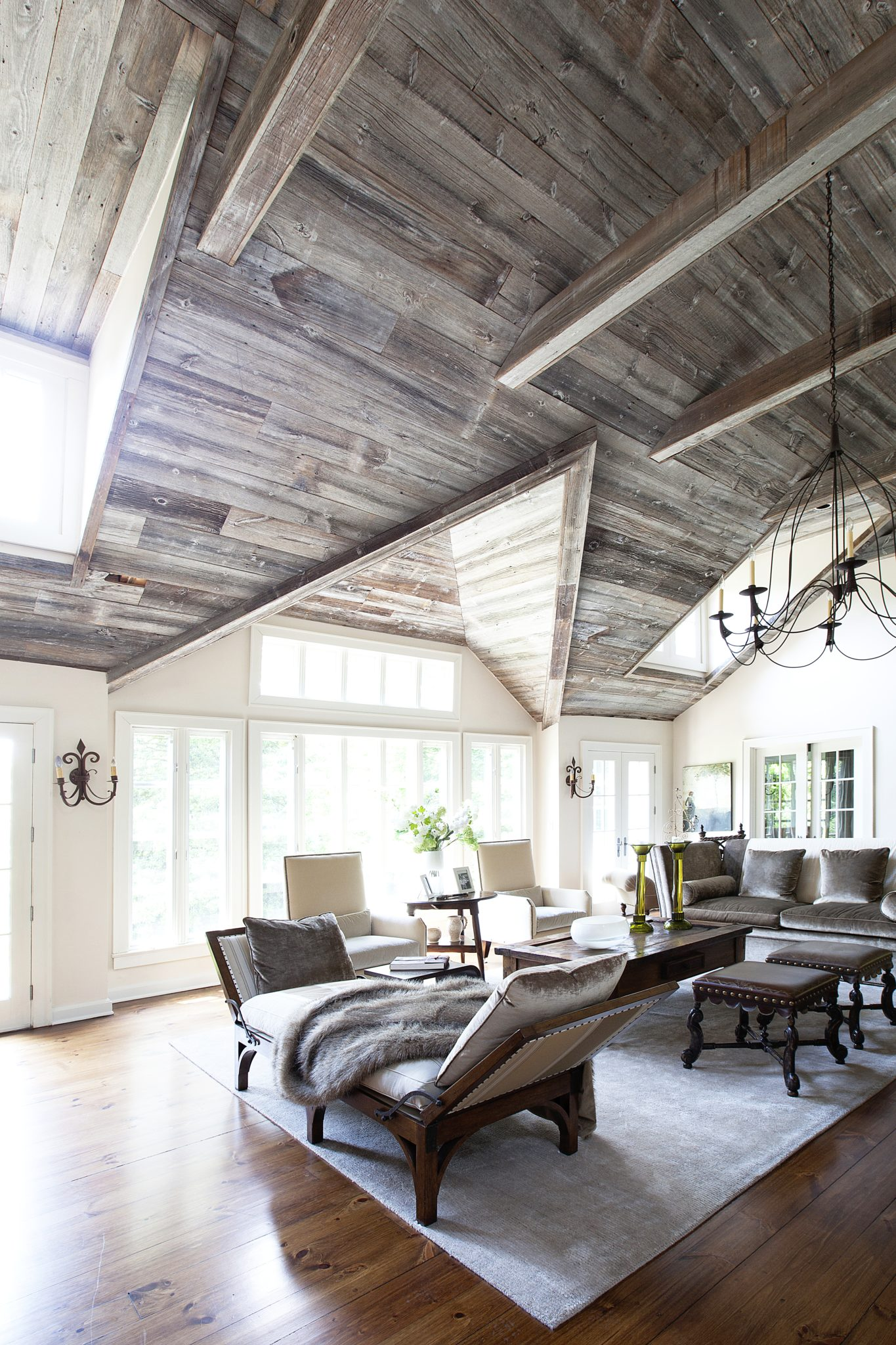 Open plan living room, mix of neutrals & textures. Reclaimed barn wood ceilings. by Laura Michaels Design