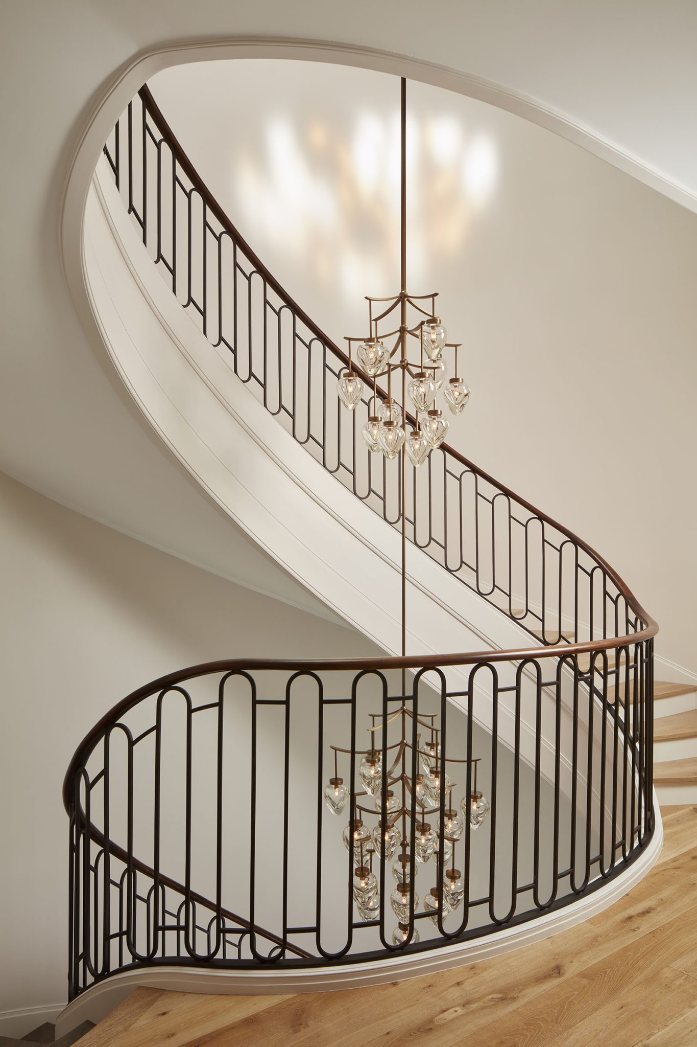 Stair Detail with Custom Light Fixture and Skylight by BGD&C Custom Homes