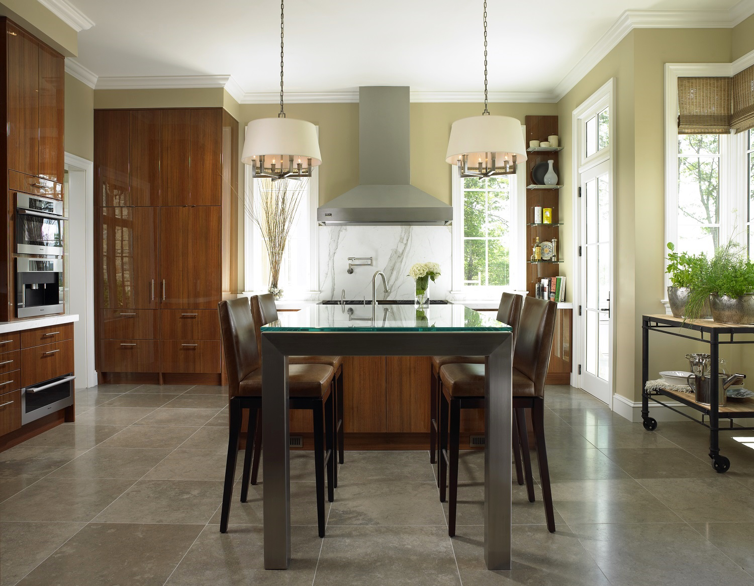 Clean lines and a mix of sleek surfaces in a New York kitchen by Jill Shevlin Design