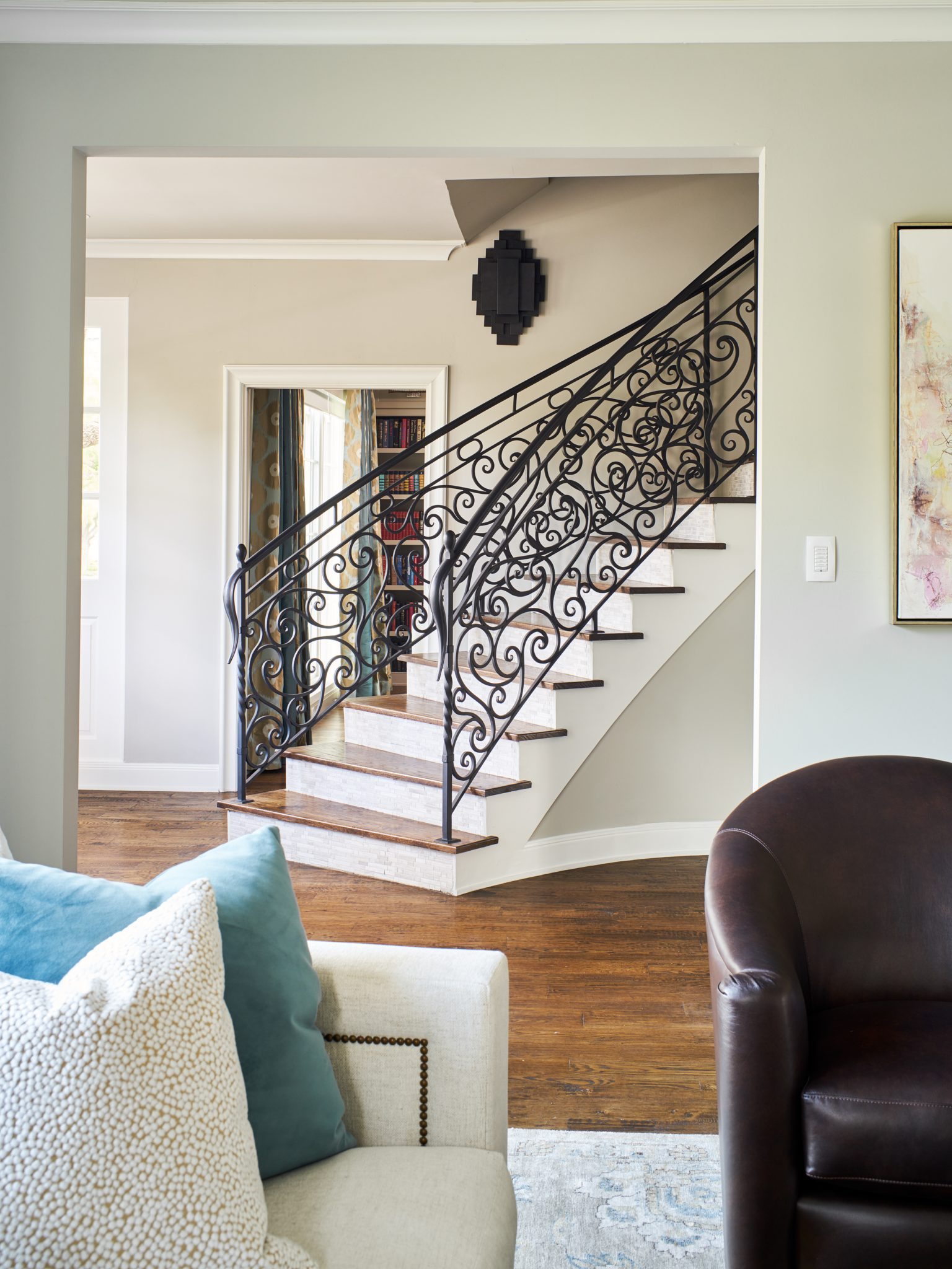 Living room views show custom iron banister work - a piece of art in itself. by Wesley-Wayne Interiors