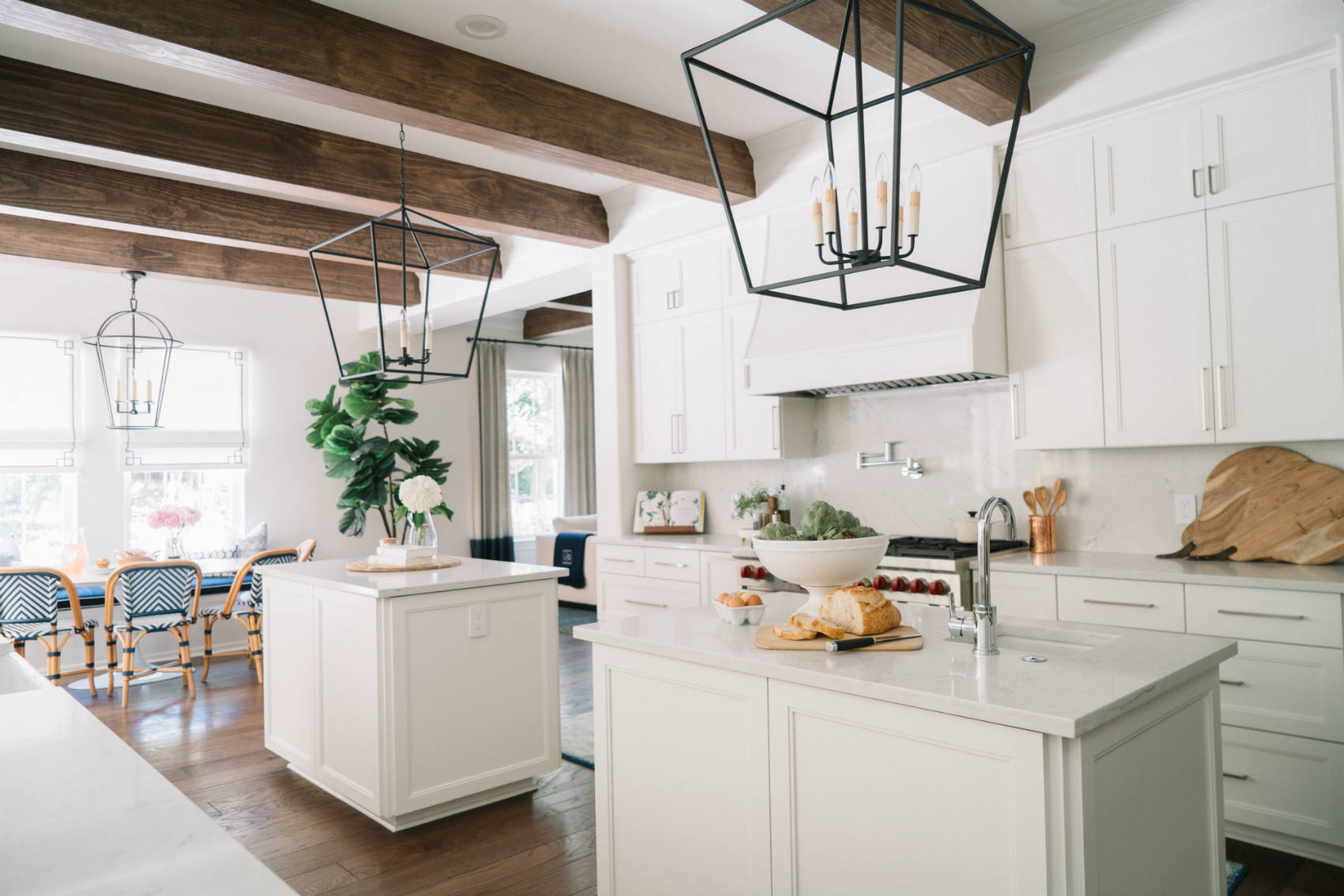 'Villa Blanca' Kitchen, Dualing Islands, Iron Pendants, Wood Beams by Heather Scott Home & Design