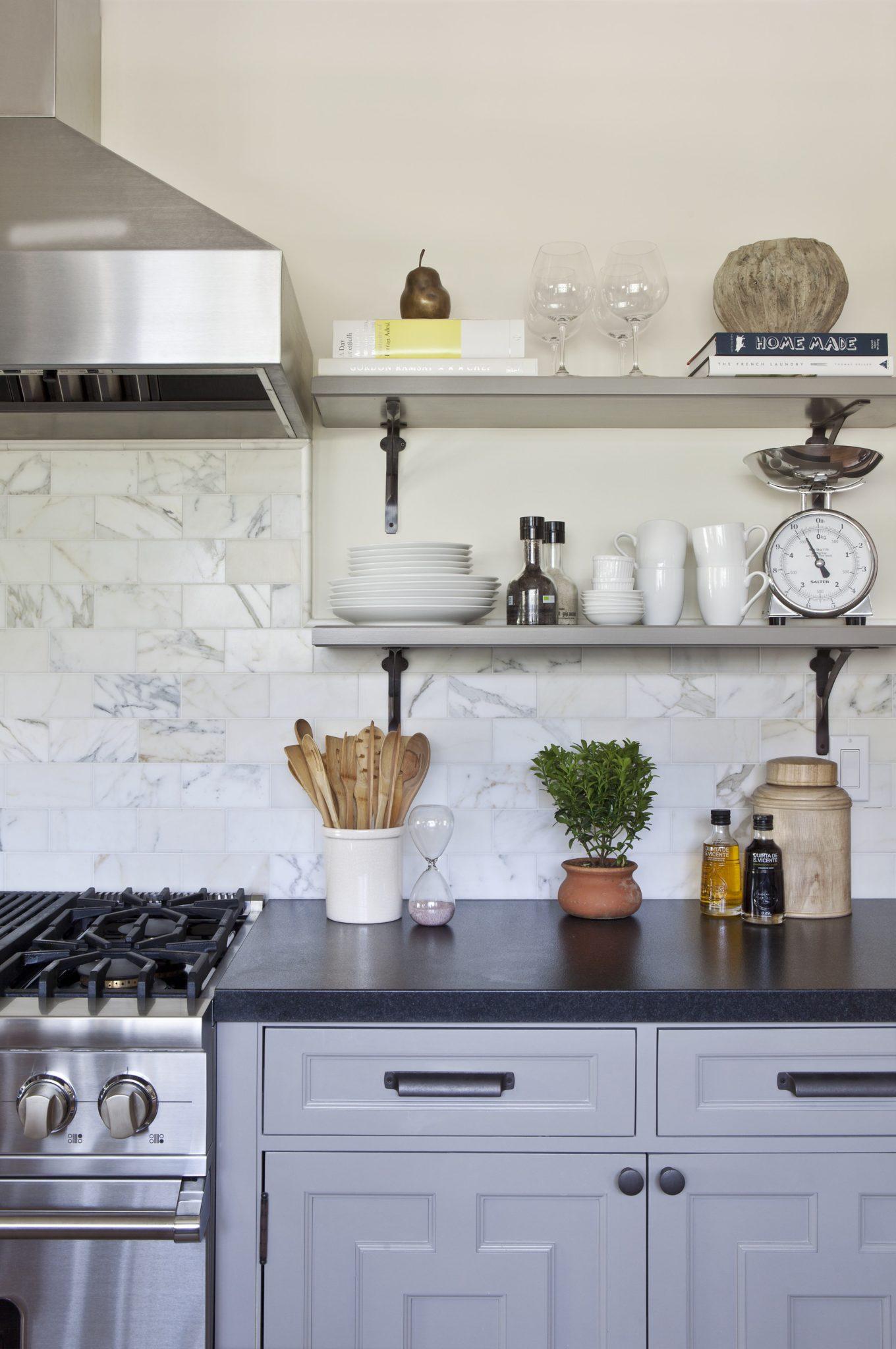 Kitchen with Carrara marble backsplash by Brown Design Group