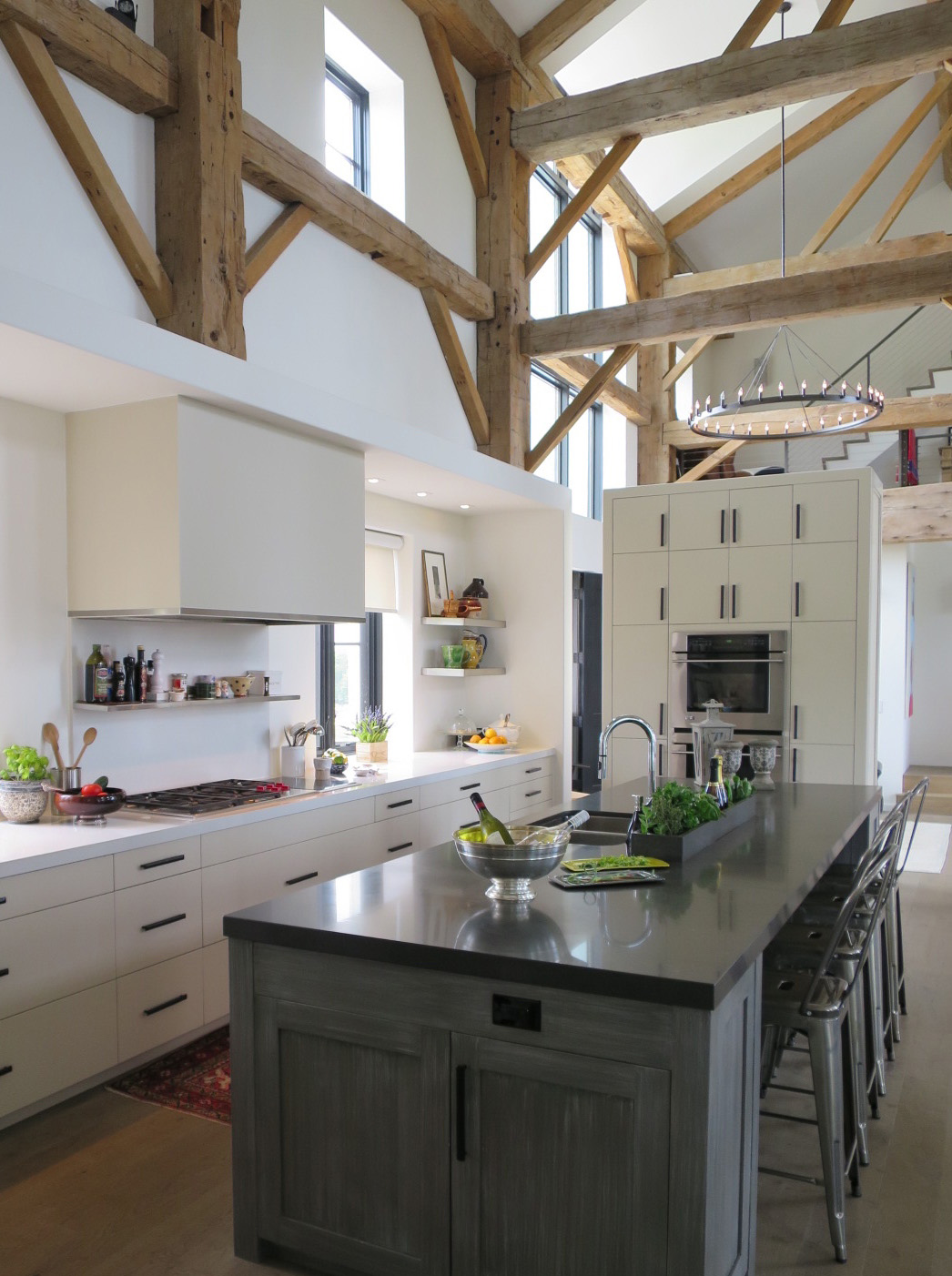 Barn Kitchen Island and appliance wall by Rowlands Associates