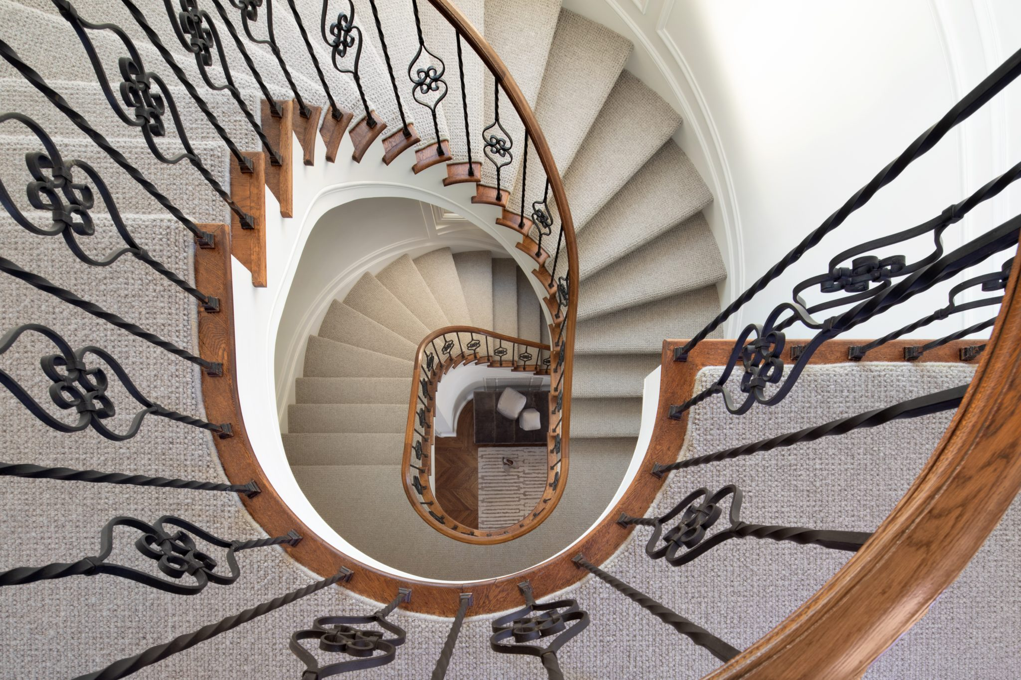 Wrought Iron and Walnut Spiral Staircase by Jeff King & Company