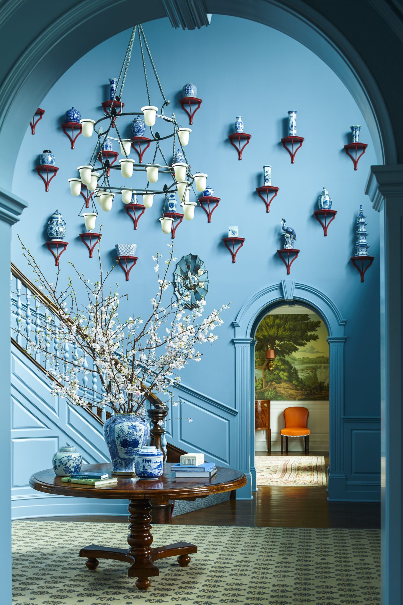 Blue foyer with wainscoting and blue and white Chinese ceramics by Katie Ridder Inc.