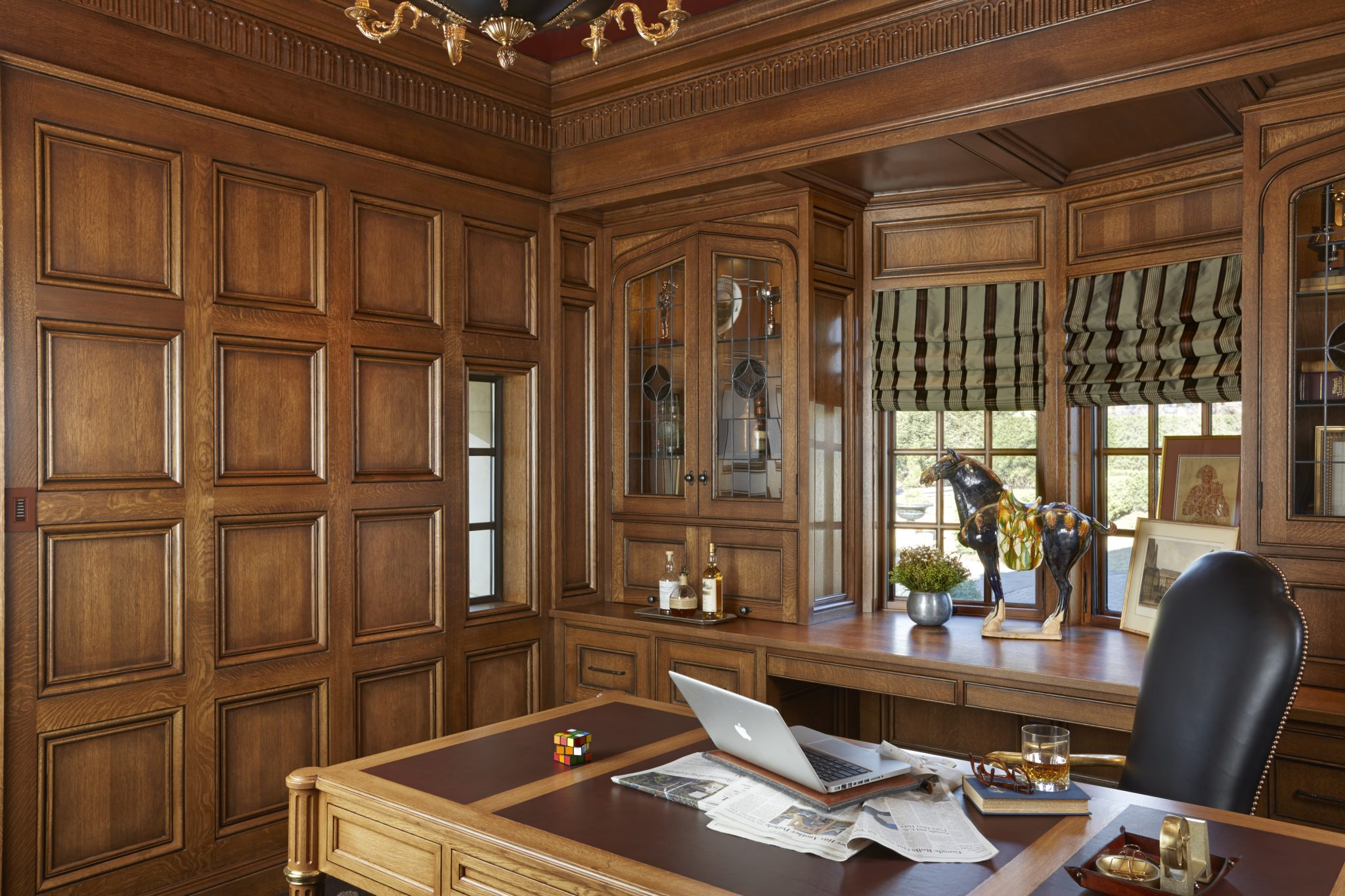 Wood Paneled Office with Leaded Glass Cabinets - Minnesota by Murphy & Co. Design