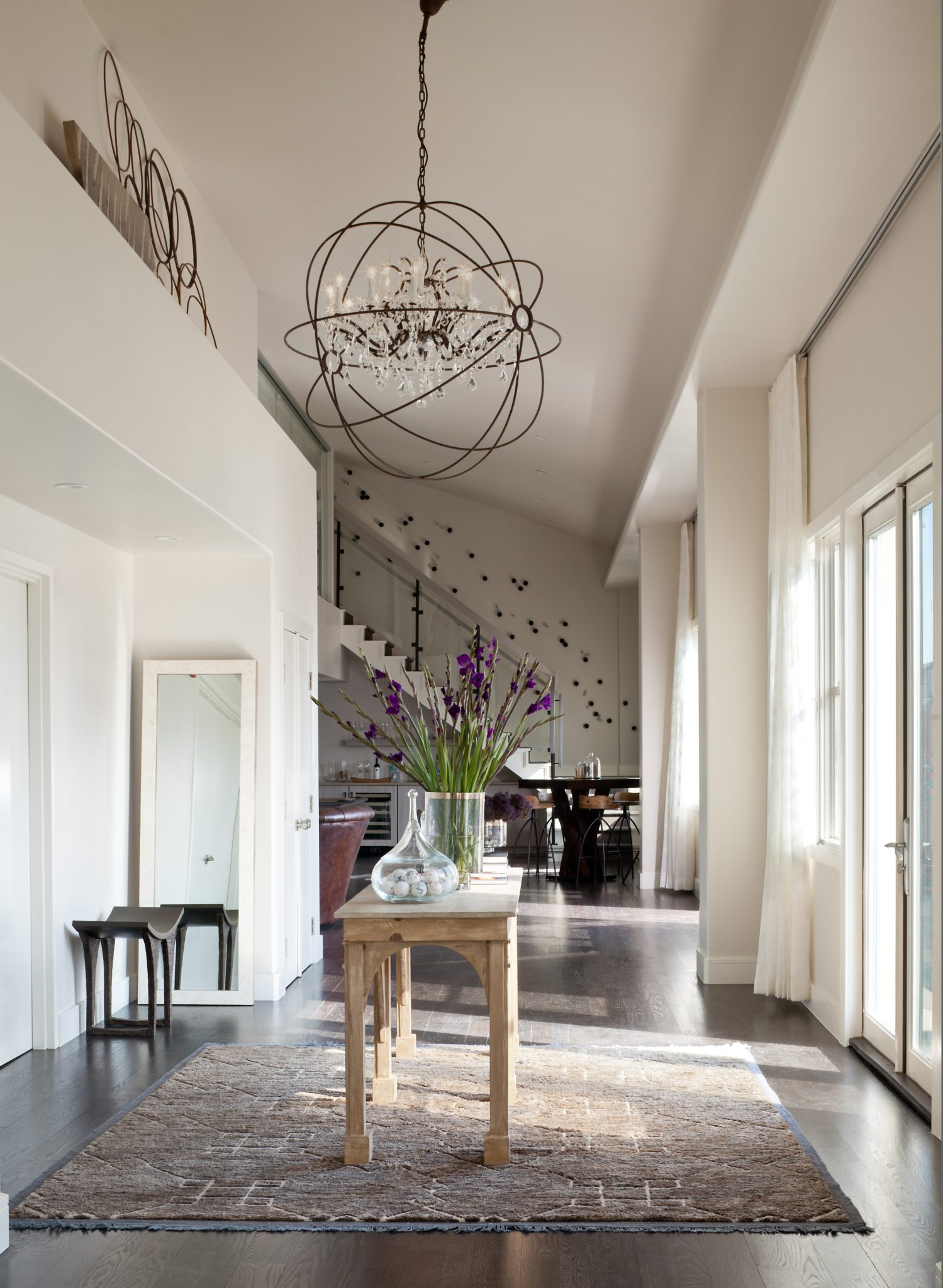 Downtown Penthouse Foyer by Ashley Campbell Interior Design