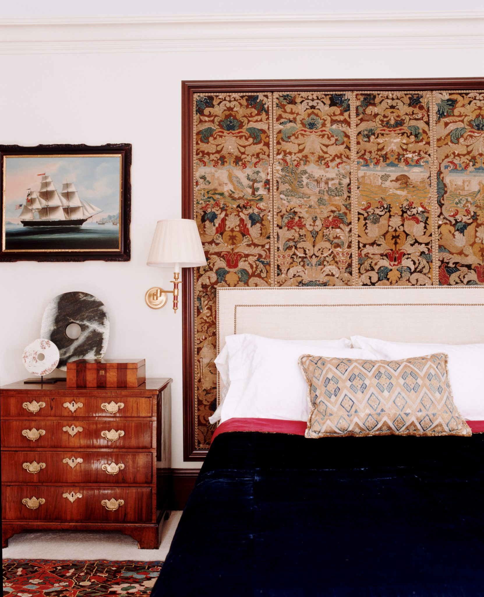 Layered looks fascinate. Here we made an architectural element out of this French needlepoint screen, using it as a second headboard. By Katie Leede & Company