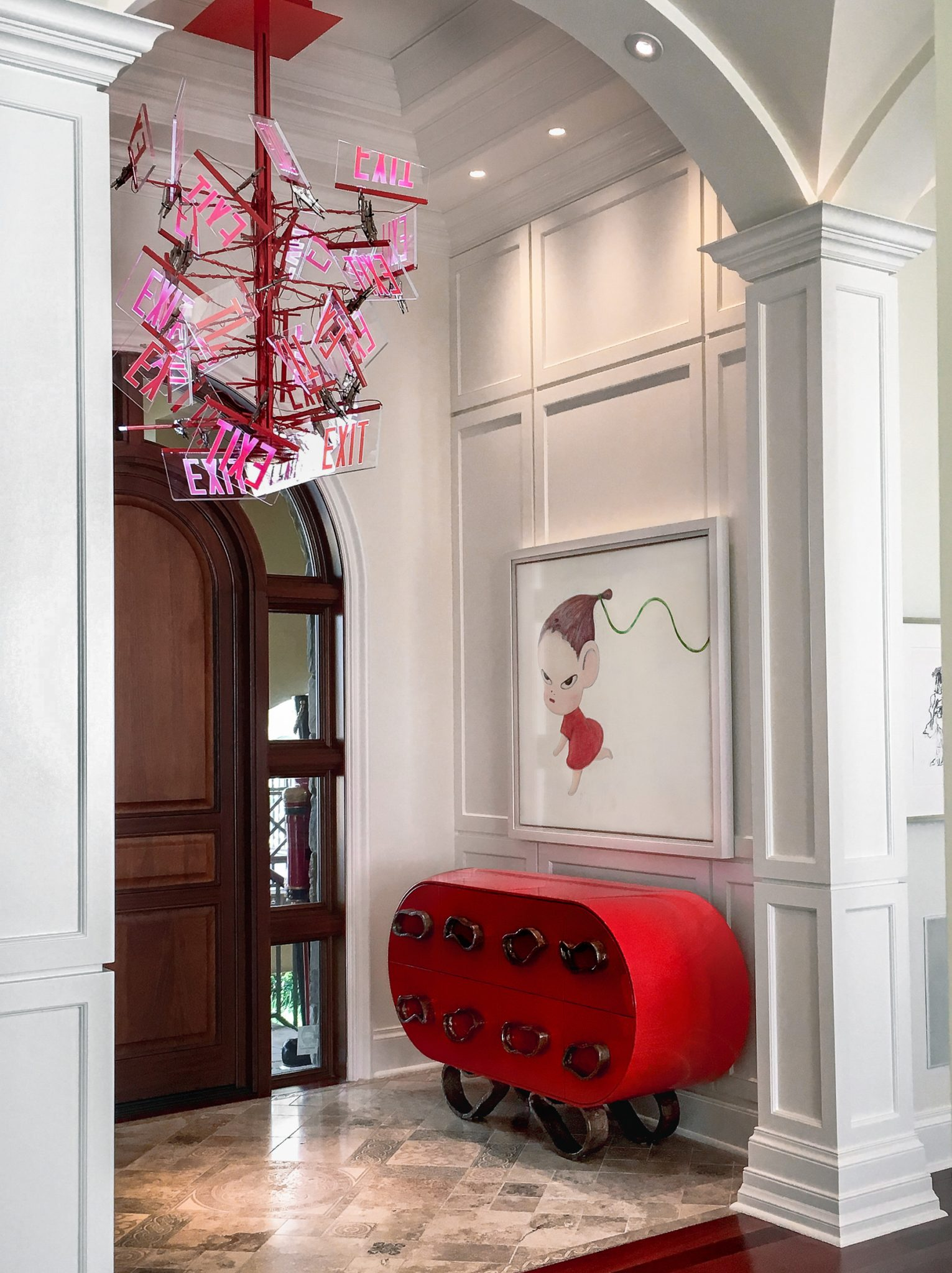 A entry greets you with bespoke lighting, cabinetry and contemporary art. by Alene Workman Interior Design