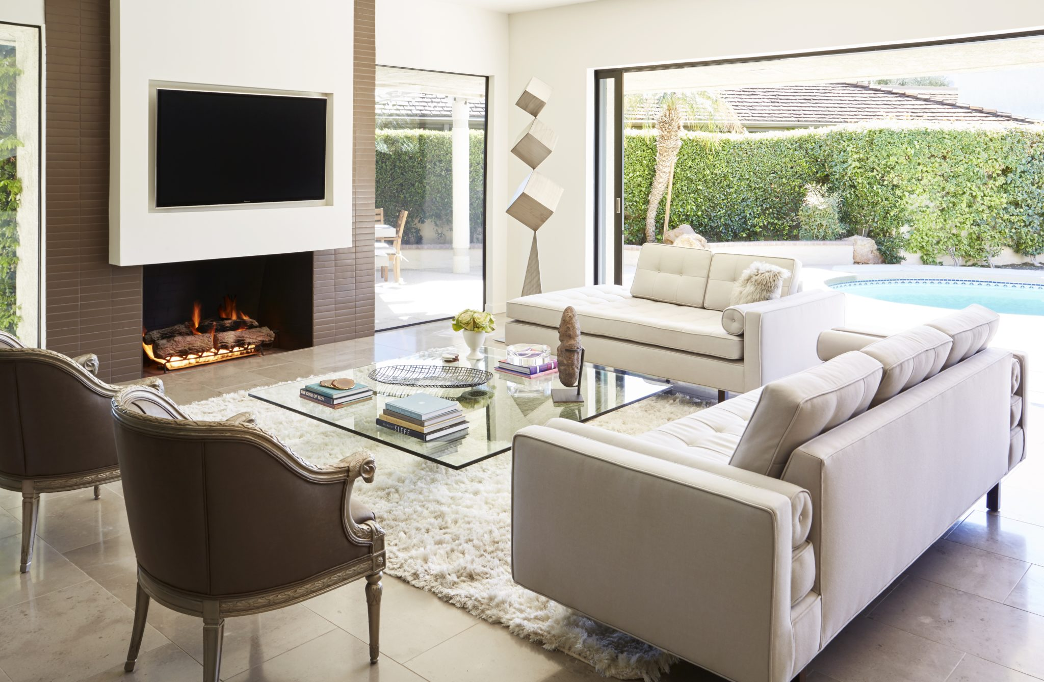 Palm Springs Living Room, indoor/outdoor living with modern tiled fireplace. by Lori Gilder Interior Makeovers Inc.