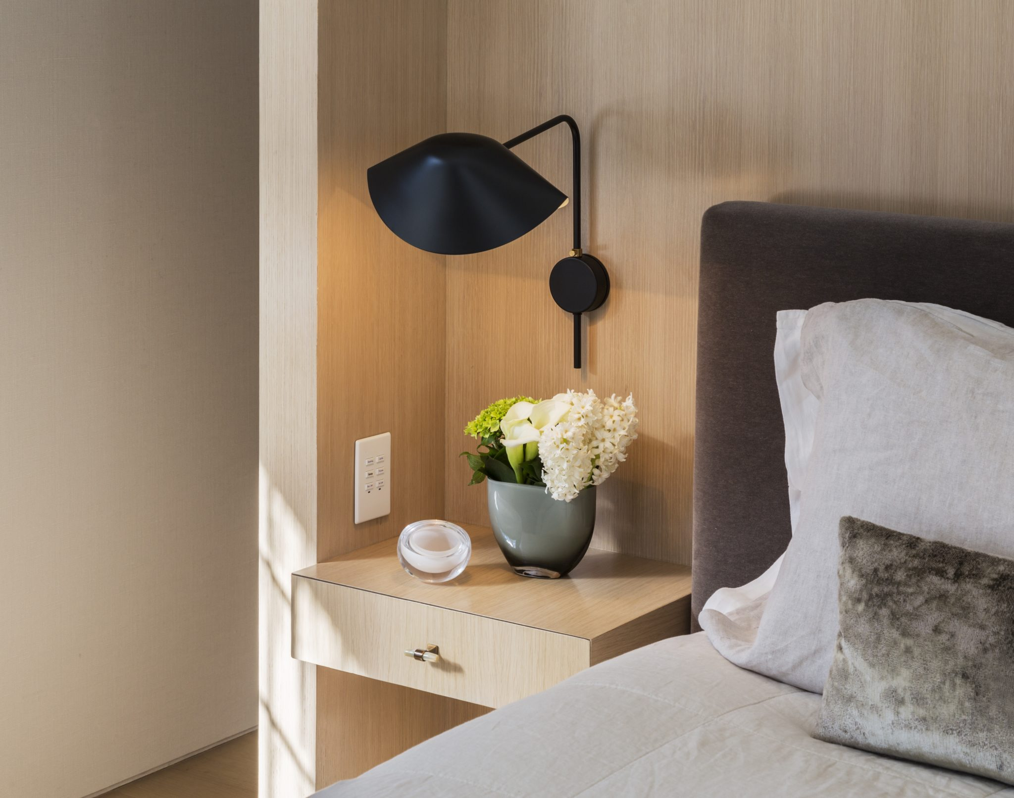 Serge Mouille sconces above the custom nightstands by Monica Fried Design