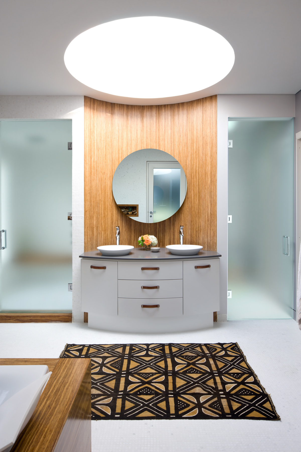 Master bathroom vanity with a giant skylight. by Estee Design