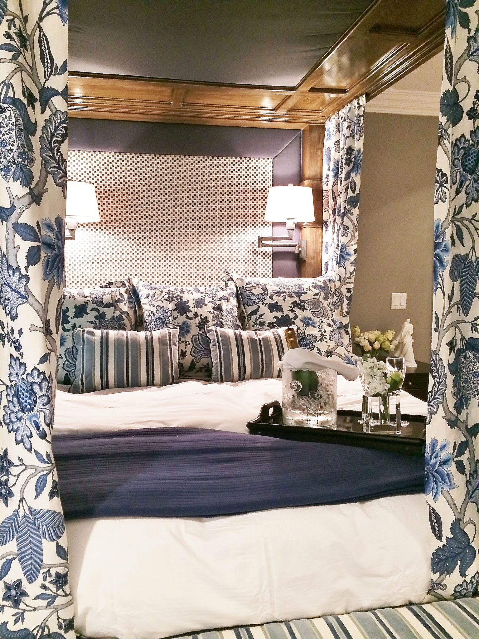 Master bedroom - cozy curtaining, warm woods, and comfy cushioned headboard by Juli Baier Interior Design