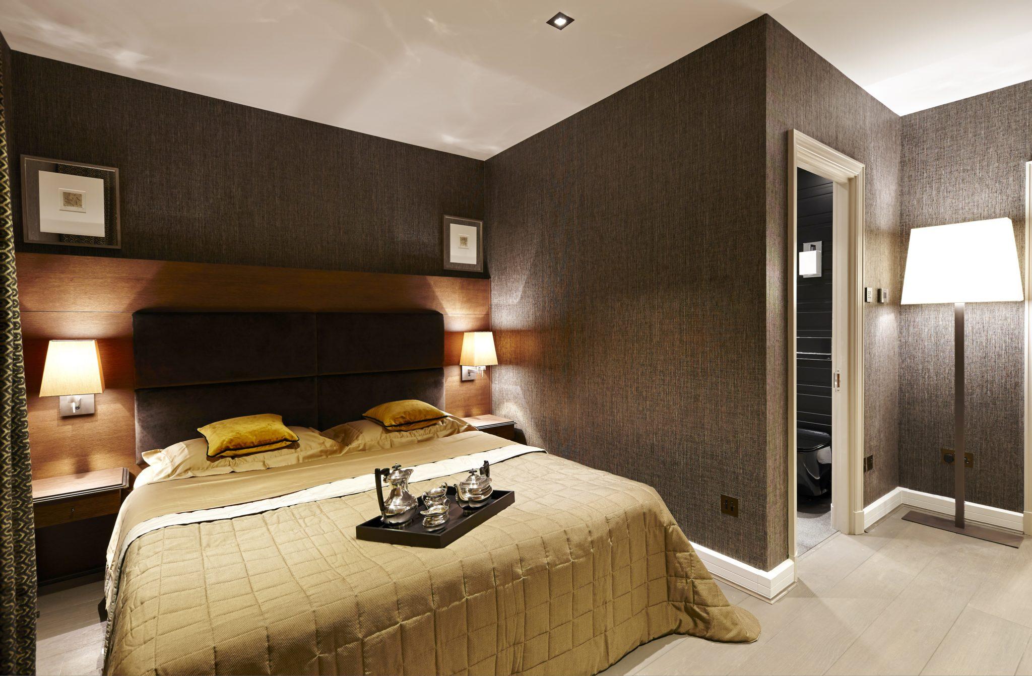 Master bedroom by Keir Townsend Interiors Ltd