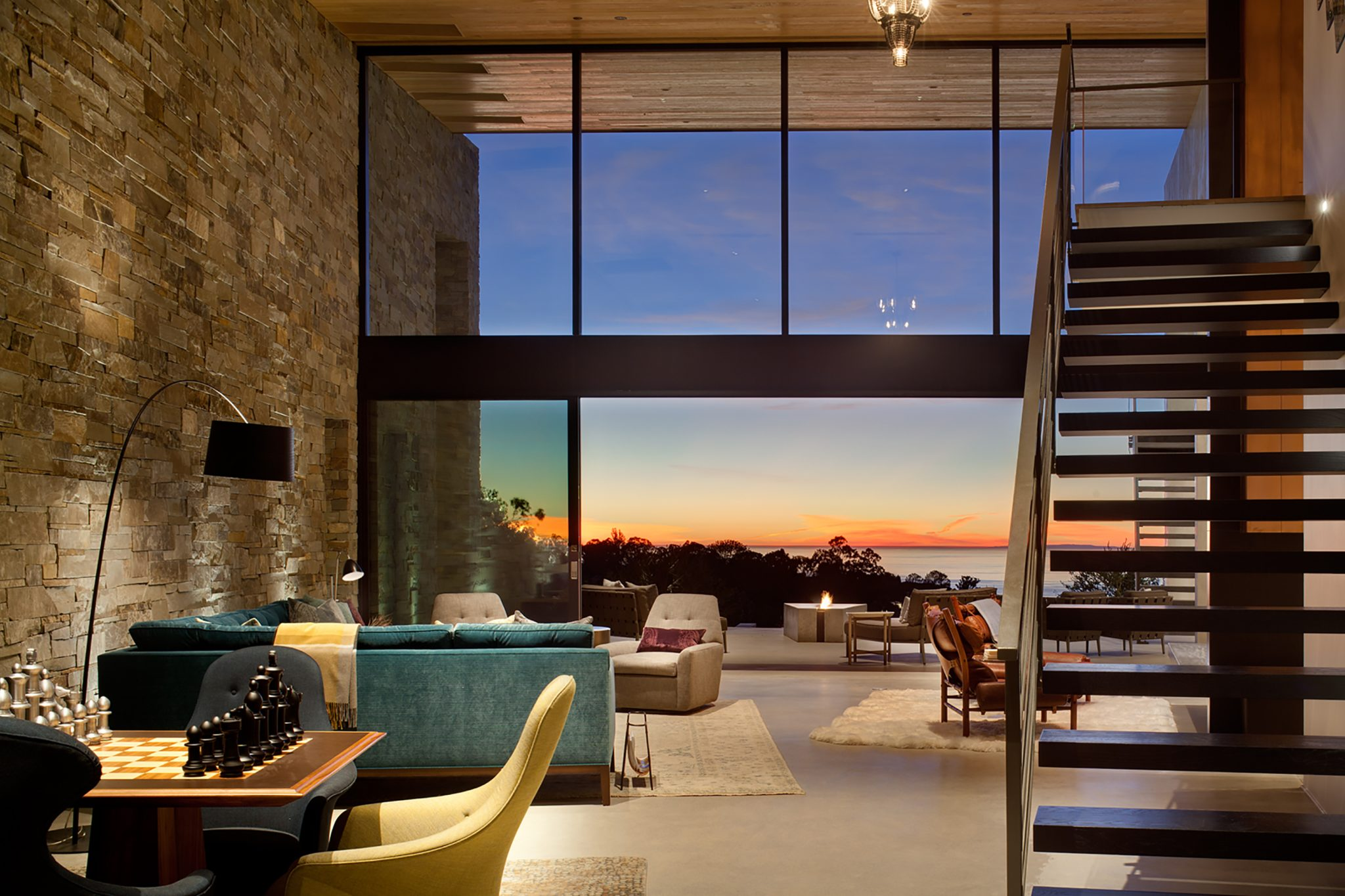 La Jolla Cliff House, great room that opens up to outdoor terrace with view by Dawson Design Group