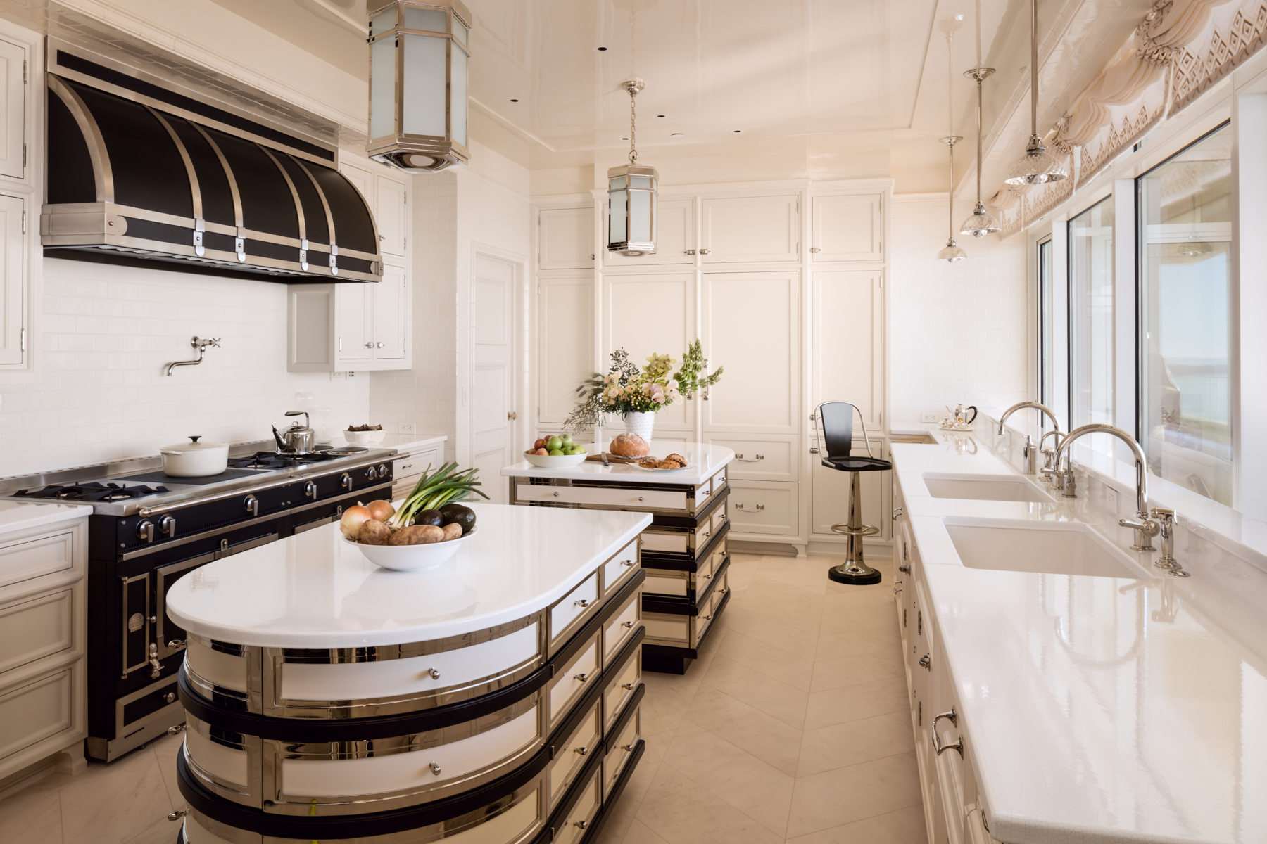 Downtown high-rise, two-story penthouse sleek kitchen with a view by Wade Weissmann Architecture Inc.