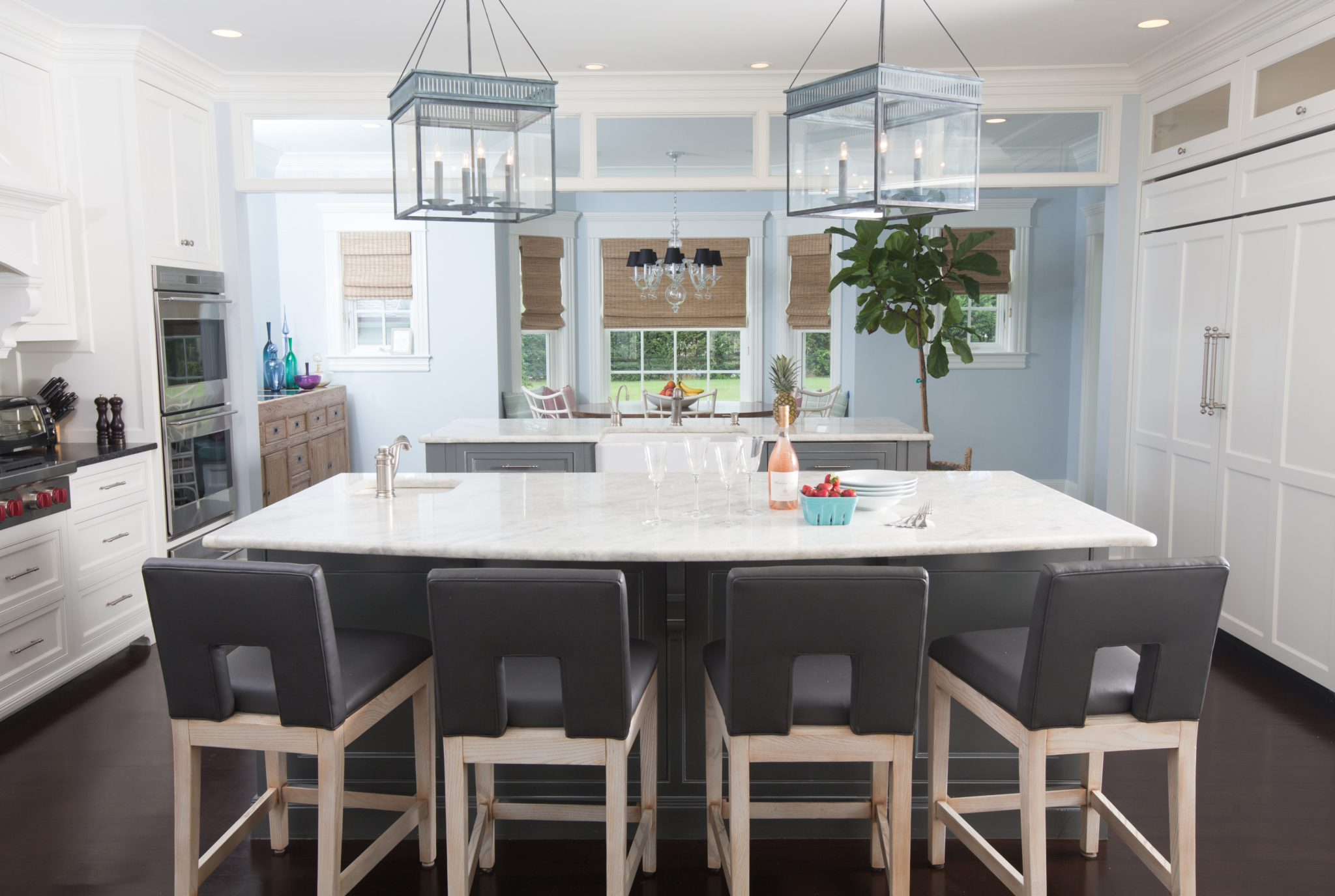 A double island in a coastal kitchen by BOWERBIRD