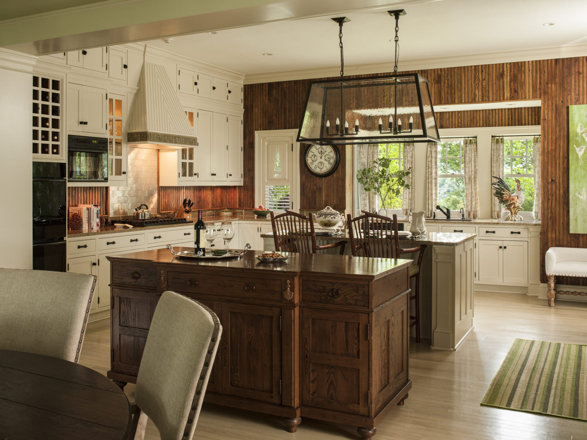 This traditional kitchen reflects the greens and browns of nature. By Taylor & Taylor