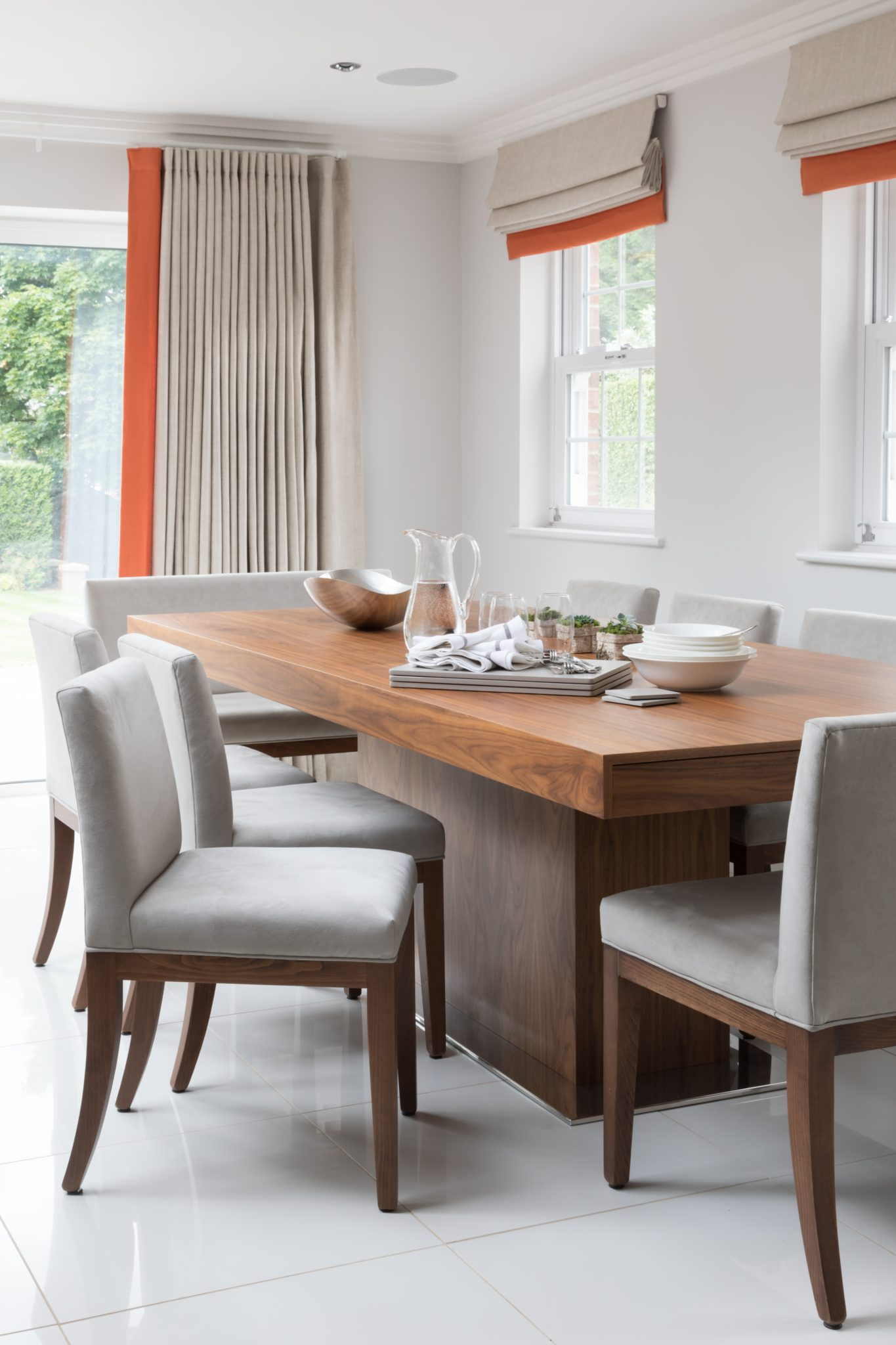 Open plan living, dining and kitchen warmth and texture with a pop of colour by dk INTERIORS