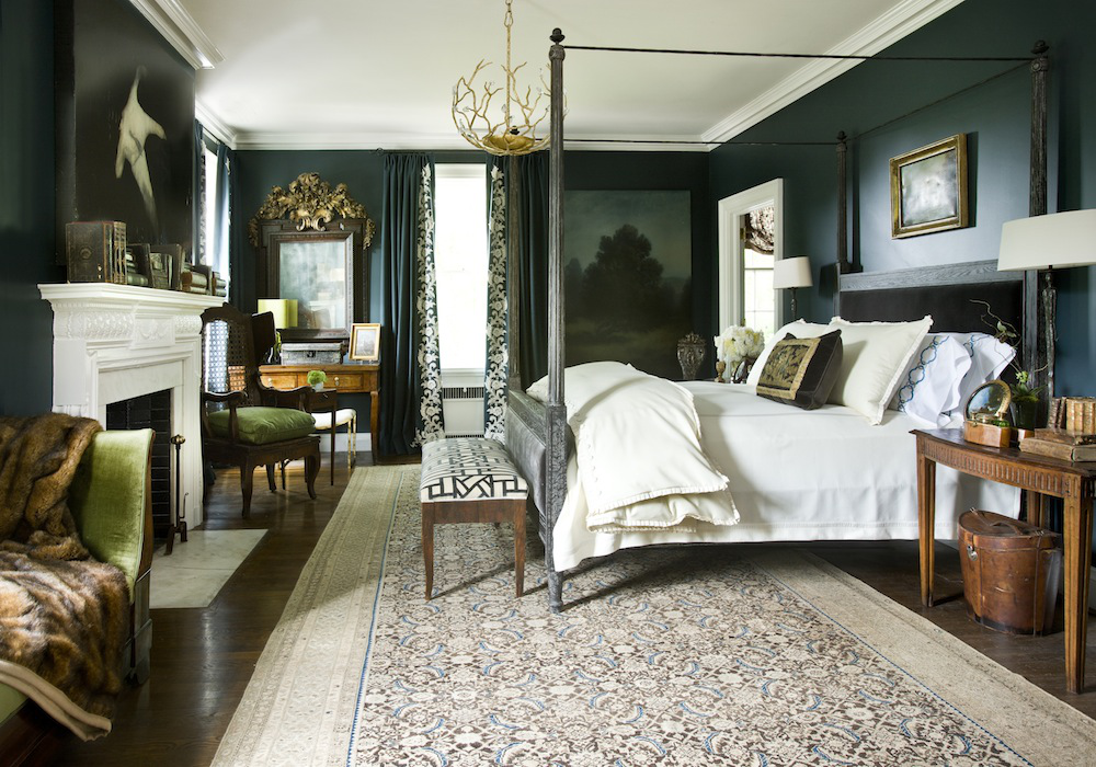 """Benjamin Moore's Narragansett Green (#HC-157)  """"A dark, dramatic bedroom provides a restful respite from a busy life. We created a warm, cozy feel here with Narragansett Green on the walls, but kept it from being overwhelming with Benjamin Moore's White Dove in a satin and flat finish on the trimwork and ceiling, respectively. Antiques mixed with soft modern artwork is one of my favorite combinations in any room and this one is no exception. The wonderful painting by Courtney Garrett across from the bed is a lovely contrast to the ornate Italian mirror on the opposite side of the window.""""  Barbara Westbrook, of Westbrook Interiors"""