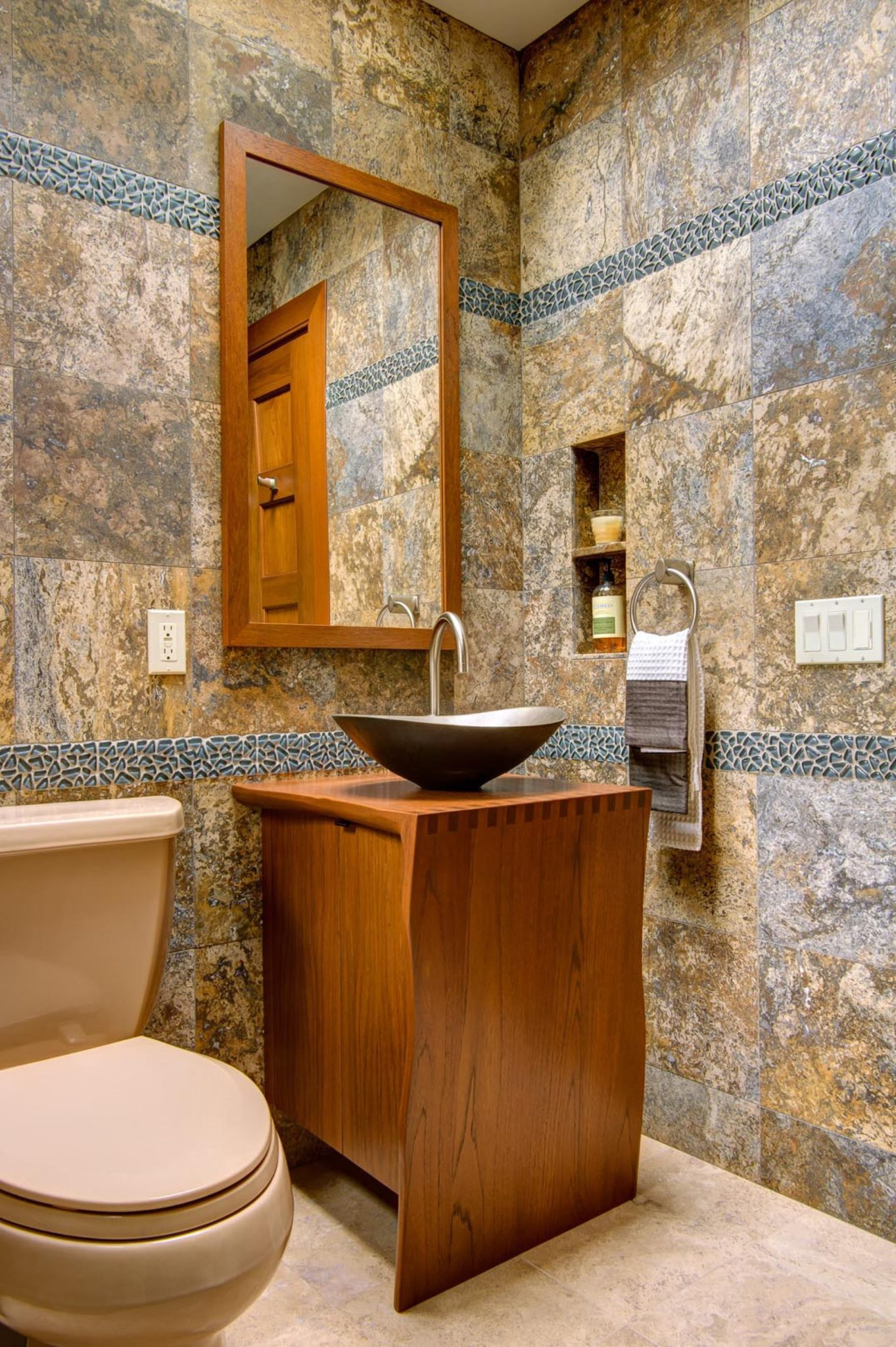 Tile and stone composition: custom Asian vanity and metal vessel sink by Susan Dearborn Interiors Inc.