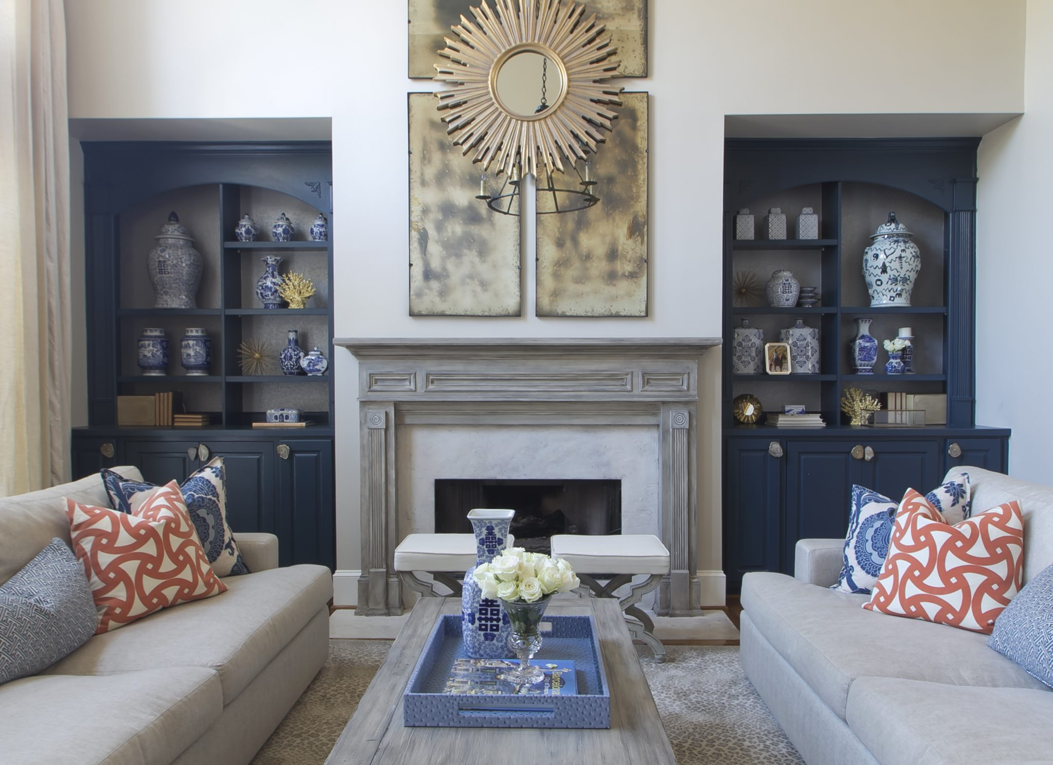 Navy and white two story living room renovation by J. Schoenberger Design