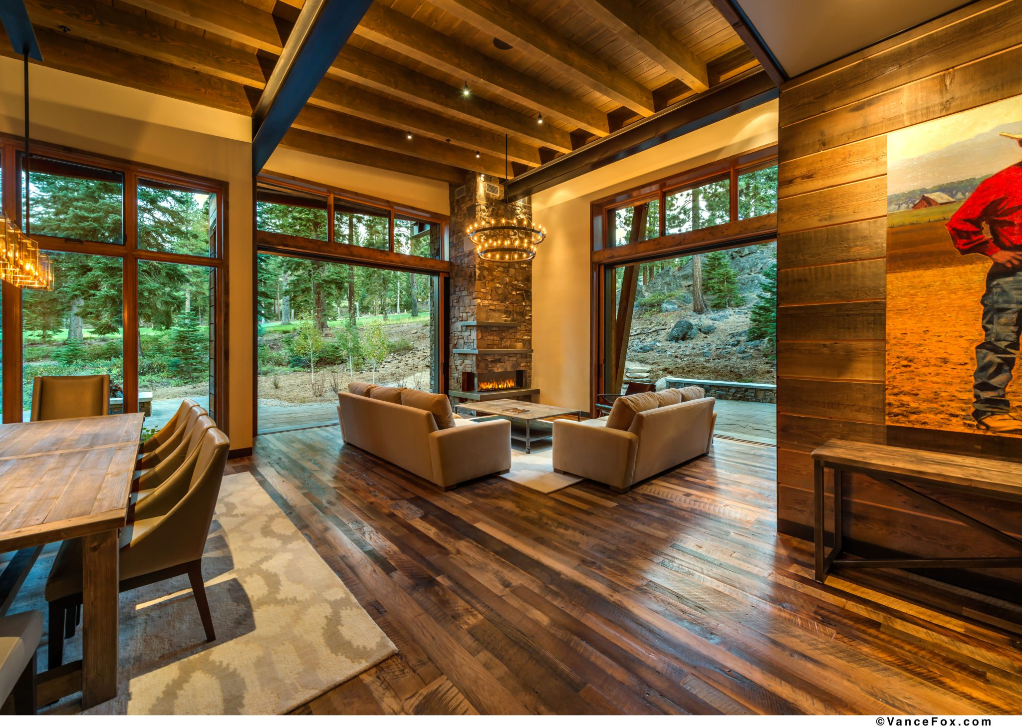 Martis Camp Rustic Home,Indoor Outdoor Living with a great room and corner fireplaceby Dennis E. Zirbel, Architect