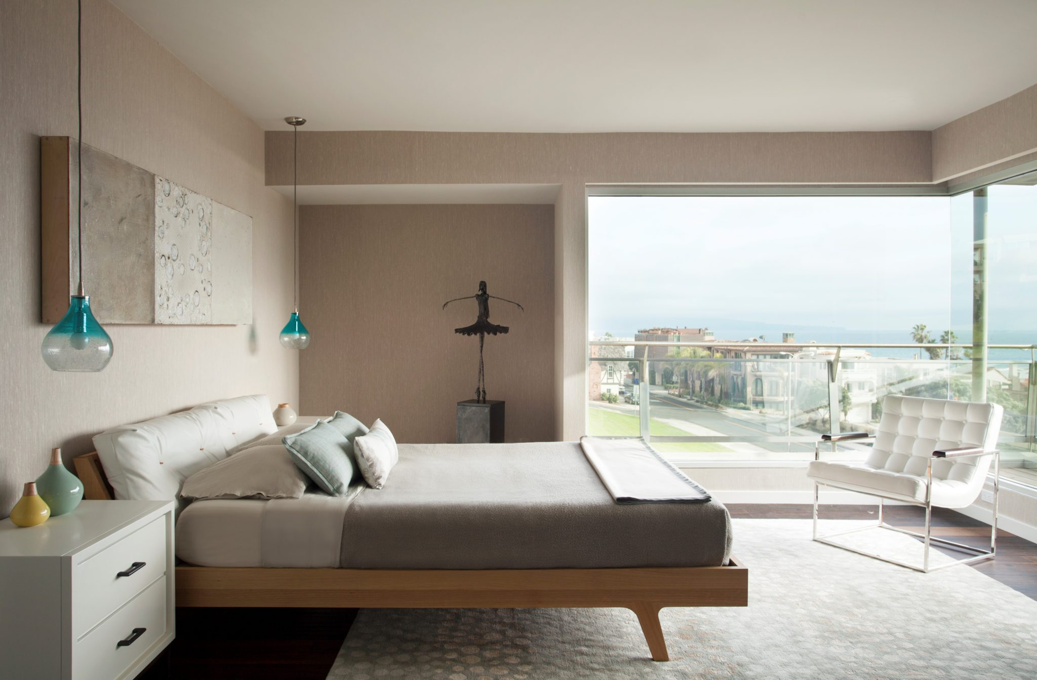 Contemporary bedroom with a view. Modern European sleek wood and leather bed. By JN Interior Spaces