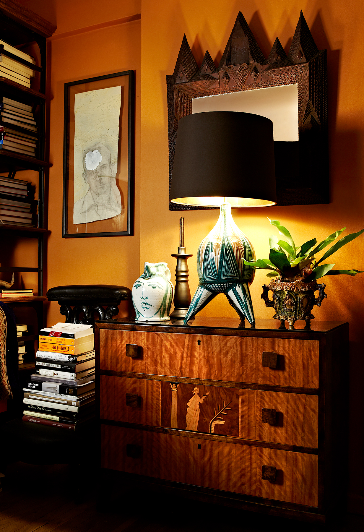 """Benjamin Moore's Autumn Orange (#2156-10)  """"This color is a personal favorite. It has enough brown to keep it from being punchy, but it still reflects warmly. It's the color I painted my own apartment, and the glow it provides makes everyone's skin looks amazing.""""  Christopher Stevens"""
