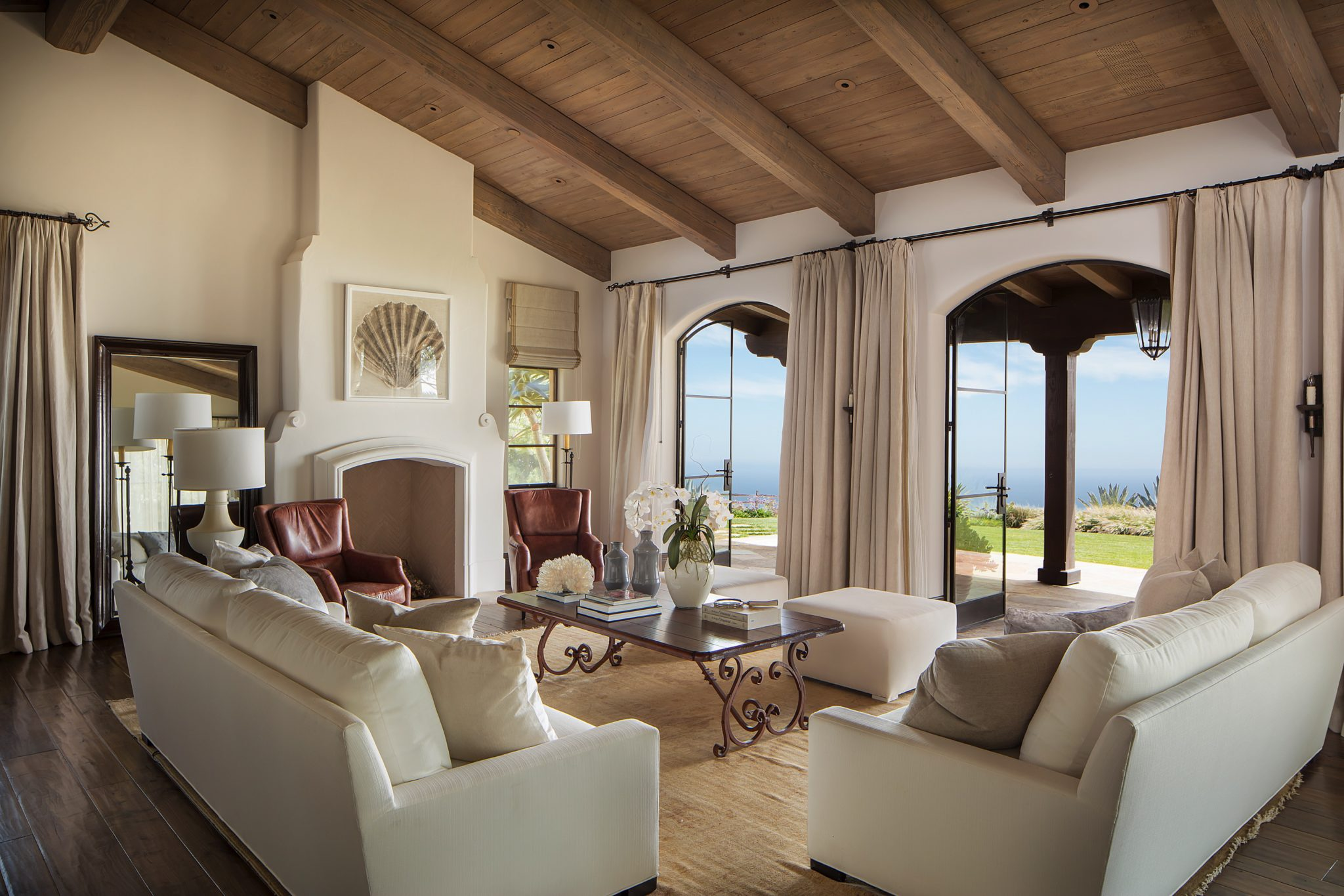 Coastal living room, featuring exposed wood beams and indoor/outdoor living by Mark Weaver